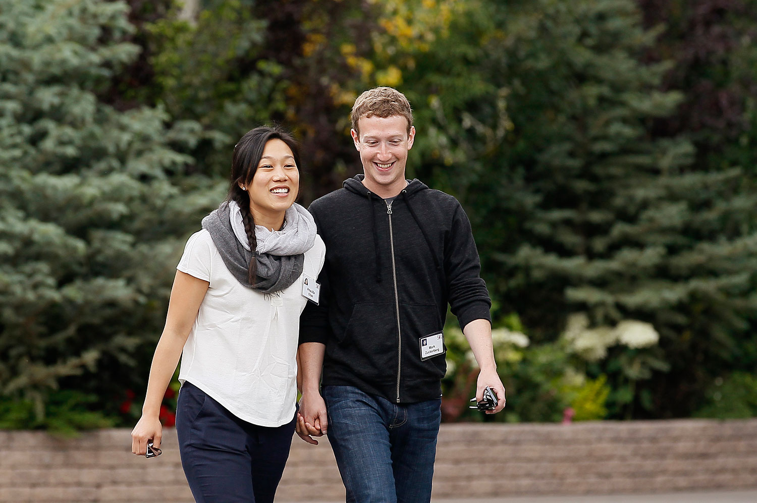 Facebook CEO Mark Zuckerberg walks with his wife Priscilla Chan at the annual Allen and Co. conference at the Sun Valley, Idaho Resort, July 11, 2013.