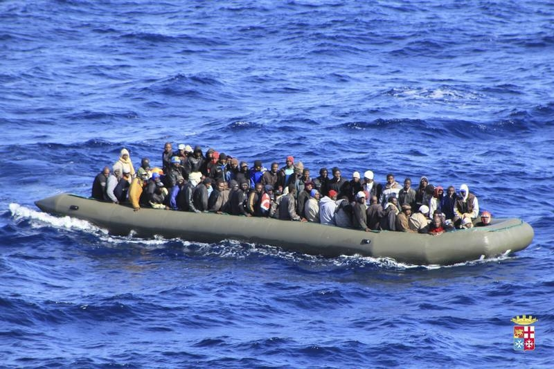 Migrants are seen in a boat after being rescued by an Italian navy ship on Feb. 5, 2014. Two boats carrying migrants capsized south of Italy in recent days