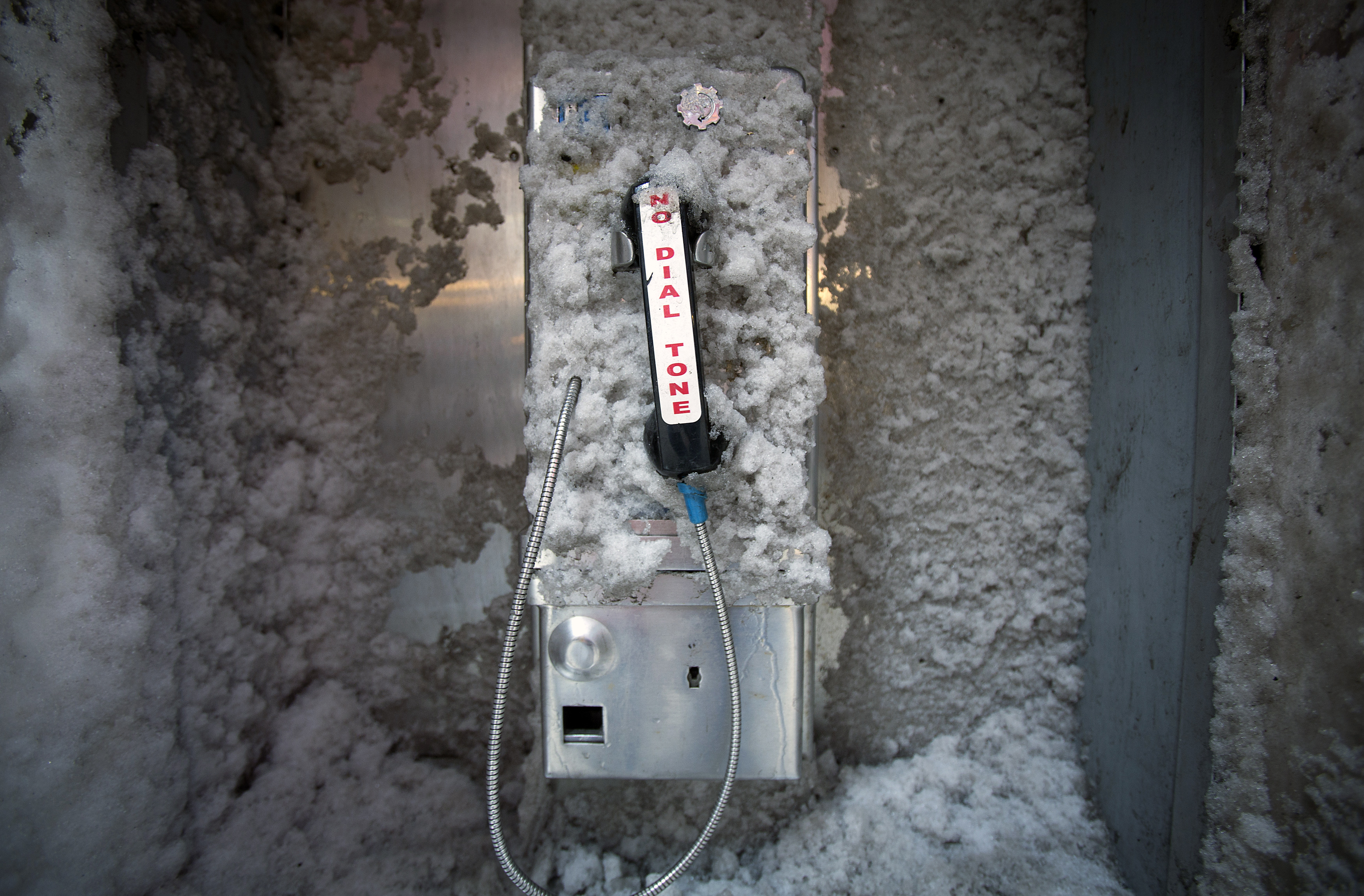 A disused pay phone is covered in snow in Times Square in New York February 5, 2014.