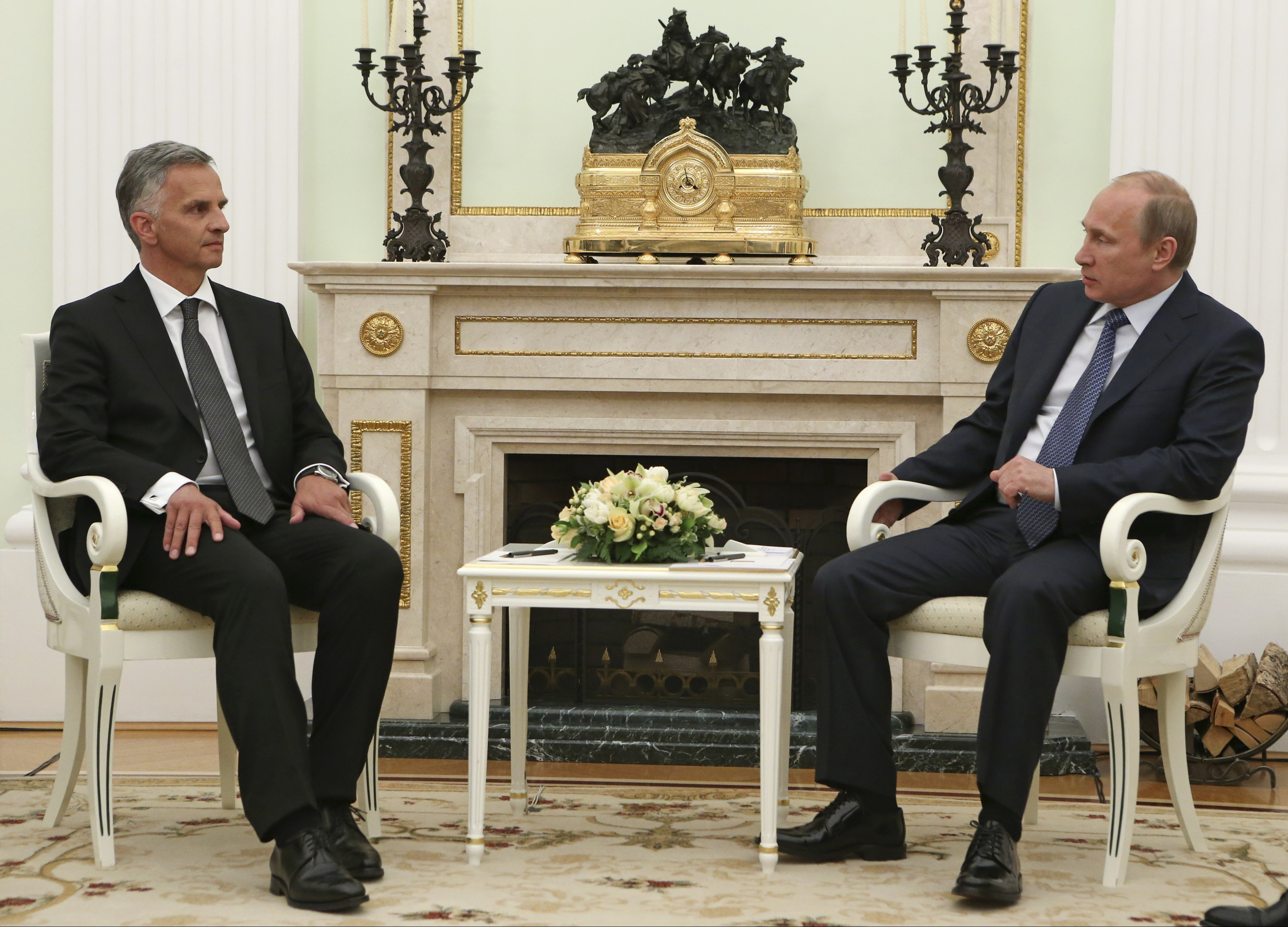 Russian President Vladimir Putin, right, and Swiss Federal President Didier Burkhalter speak at their a meeting in the Kremlin in Moscow, Wednesday, May 7, 2014.