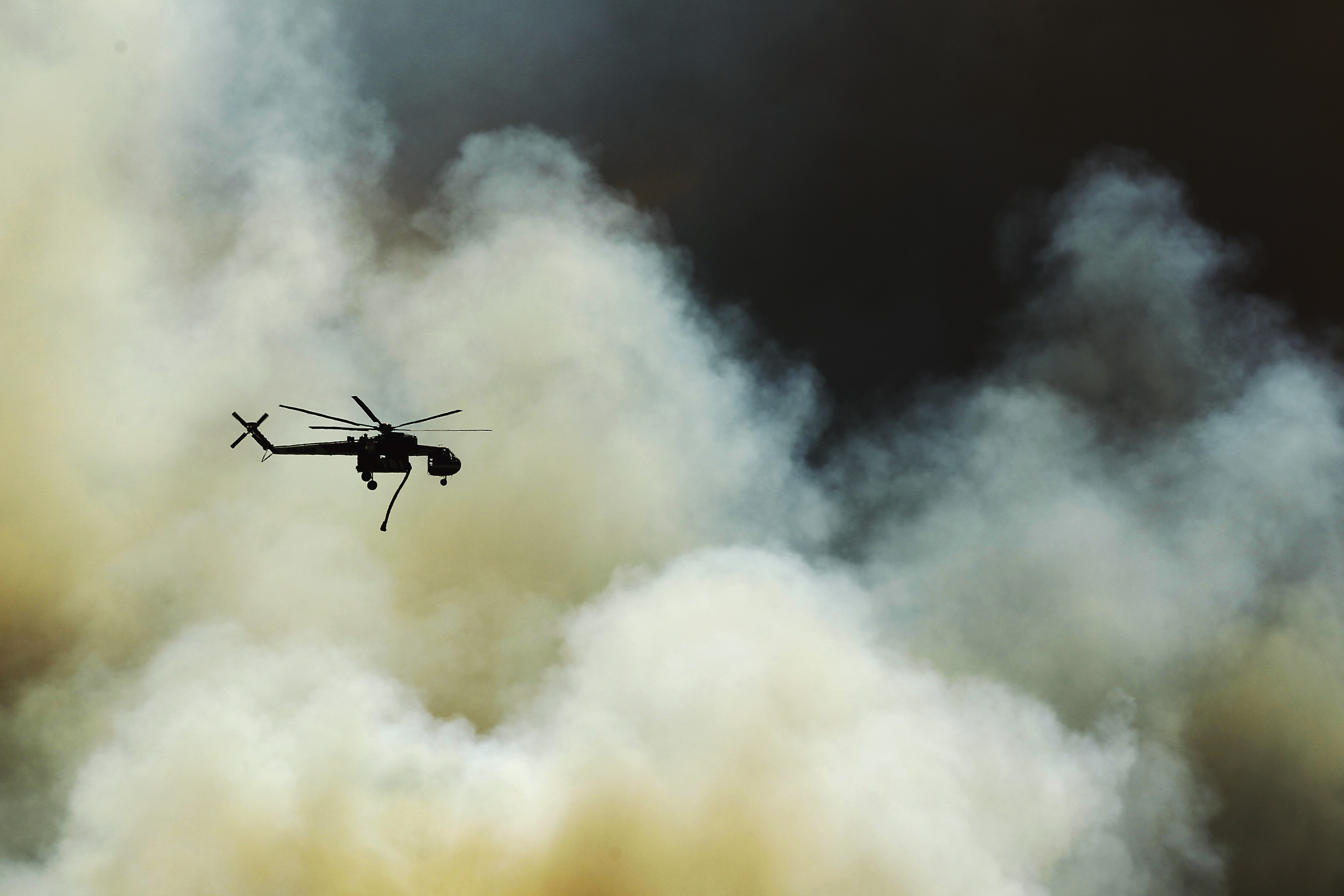 Helicopters fight fire burning near Fairbanks Ranch in San Diego on May 13, 2014.