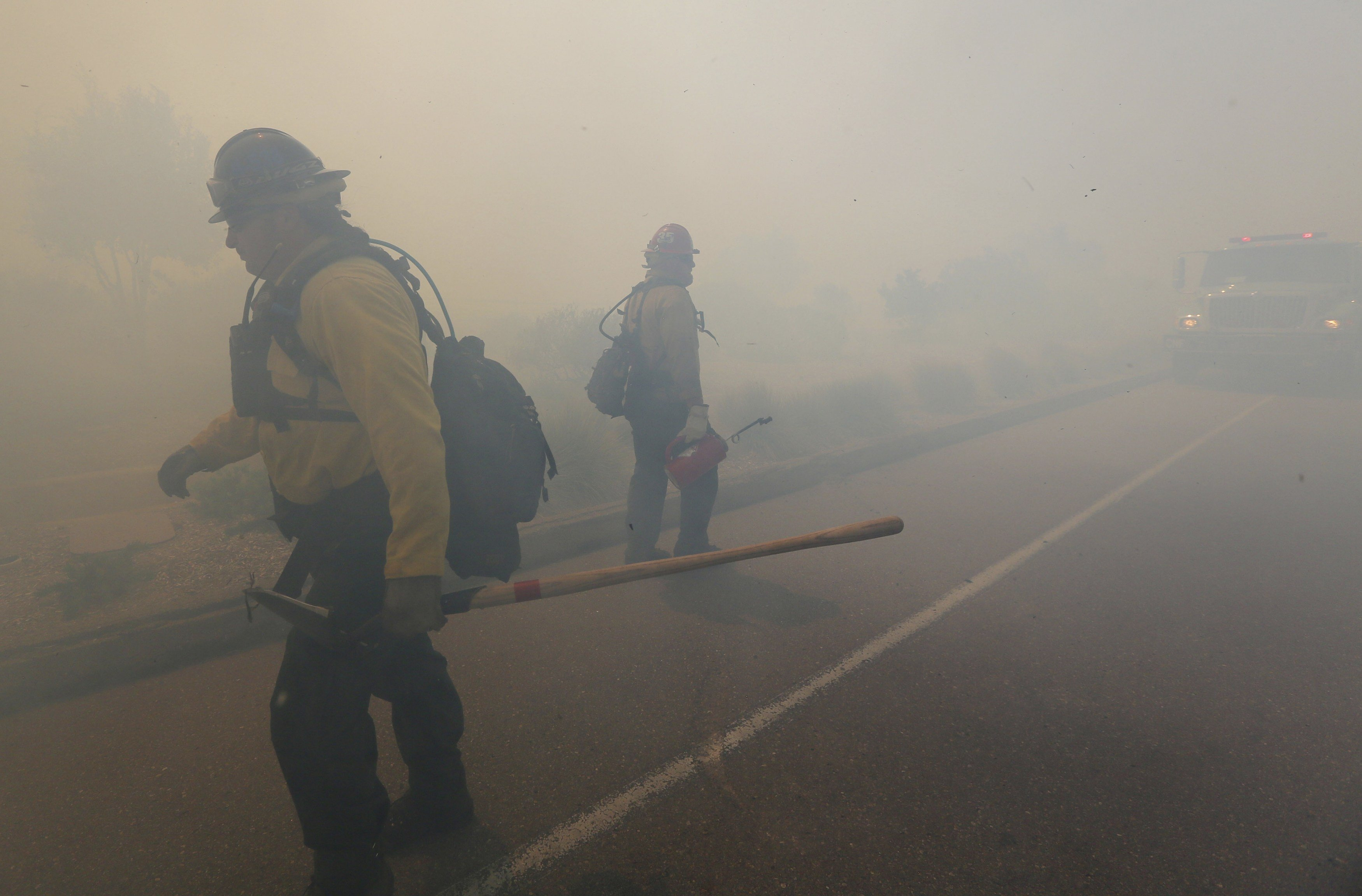 Firefighters battle the fire near San Diego on May 13, 2014.