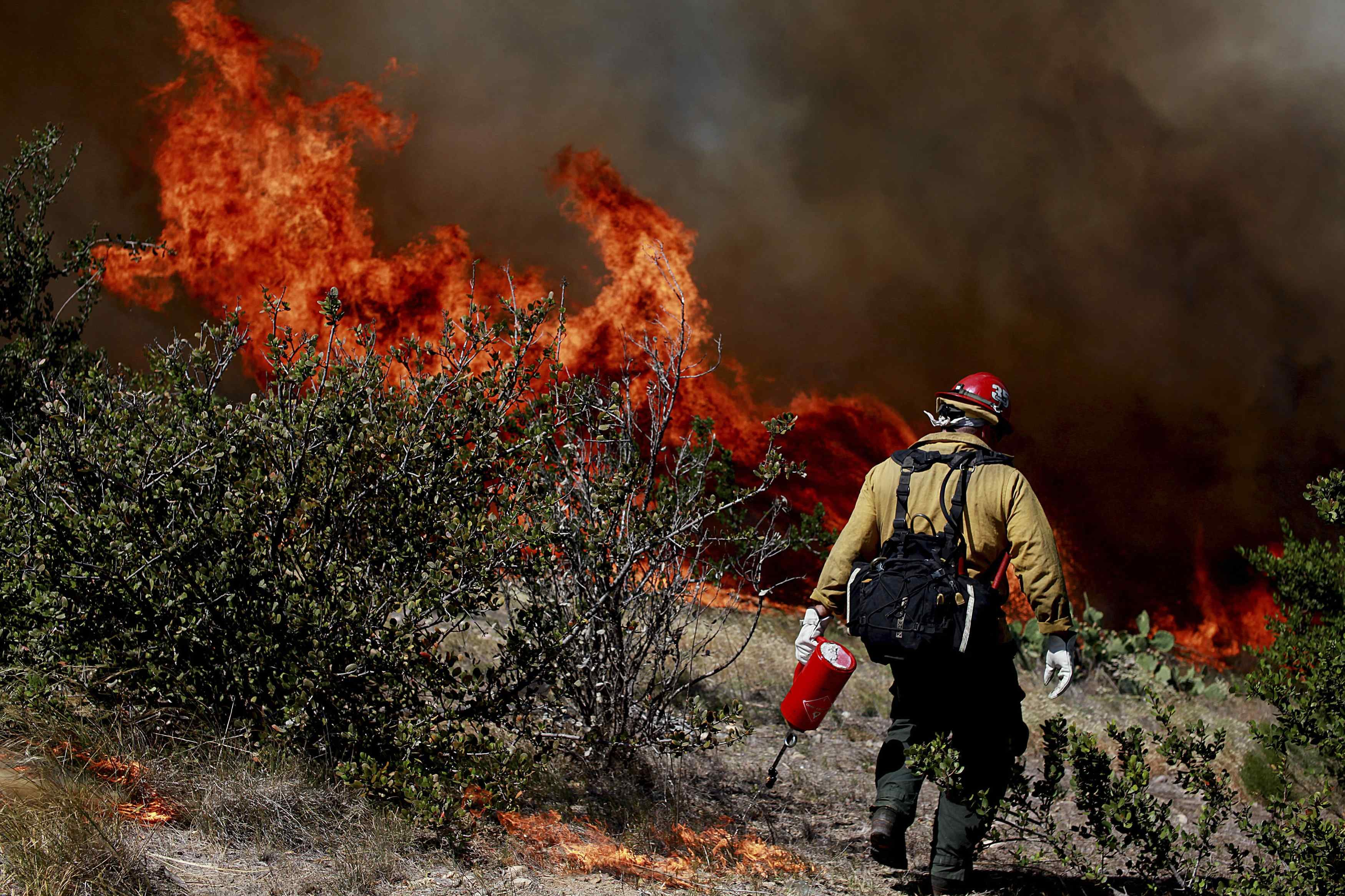 A firefighter battles the fire near San Diego on May 13, 2014.