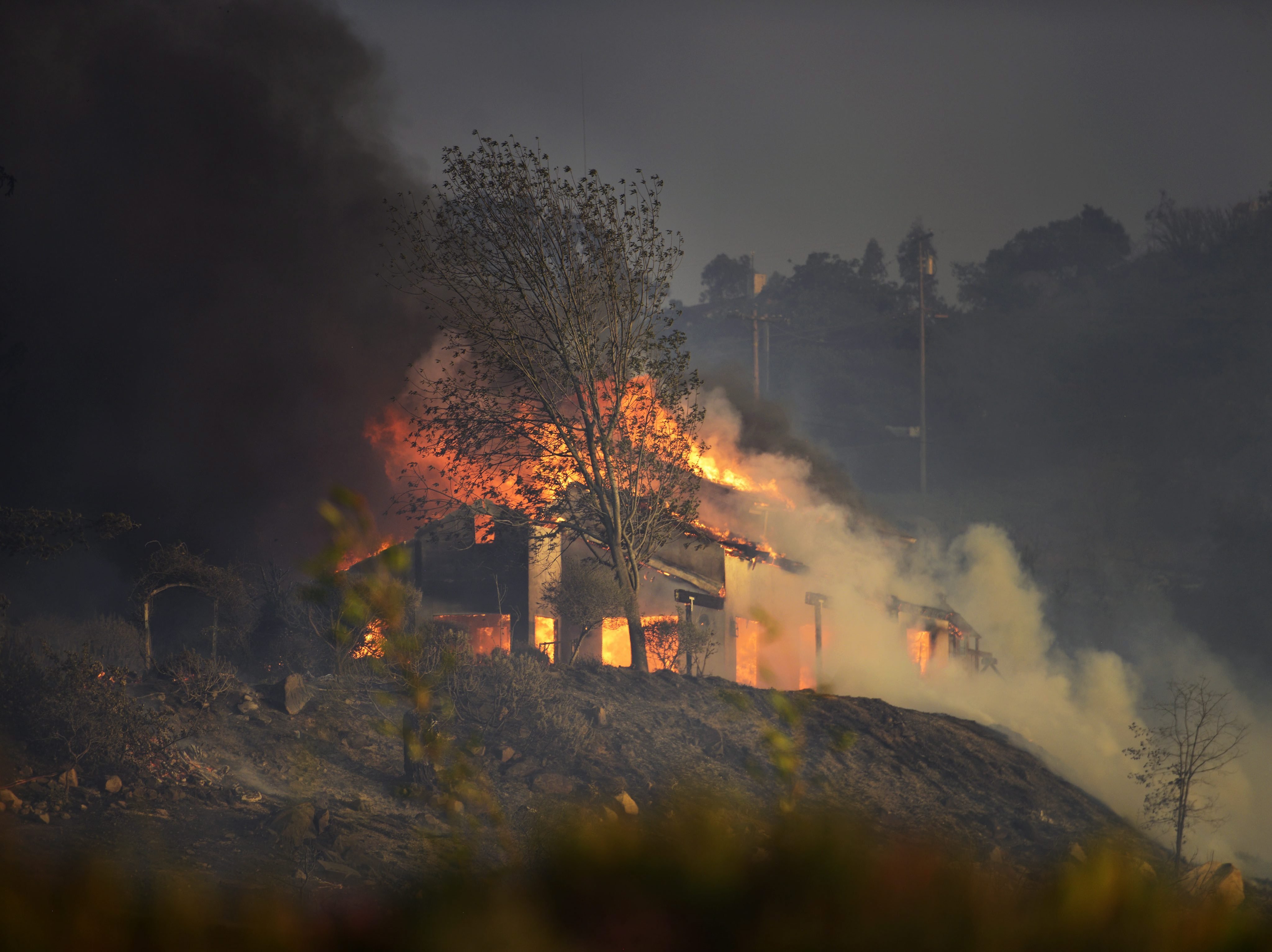 A home burns on top of a hill in San Marcos, San Diego county on May 14, 2014.