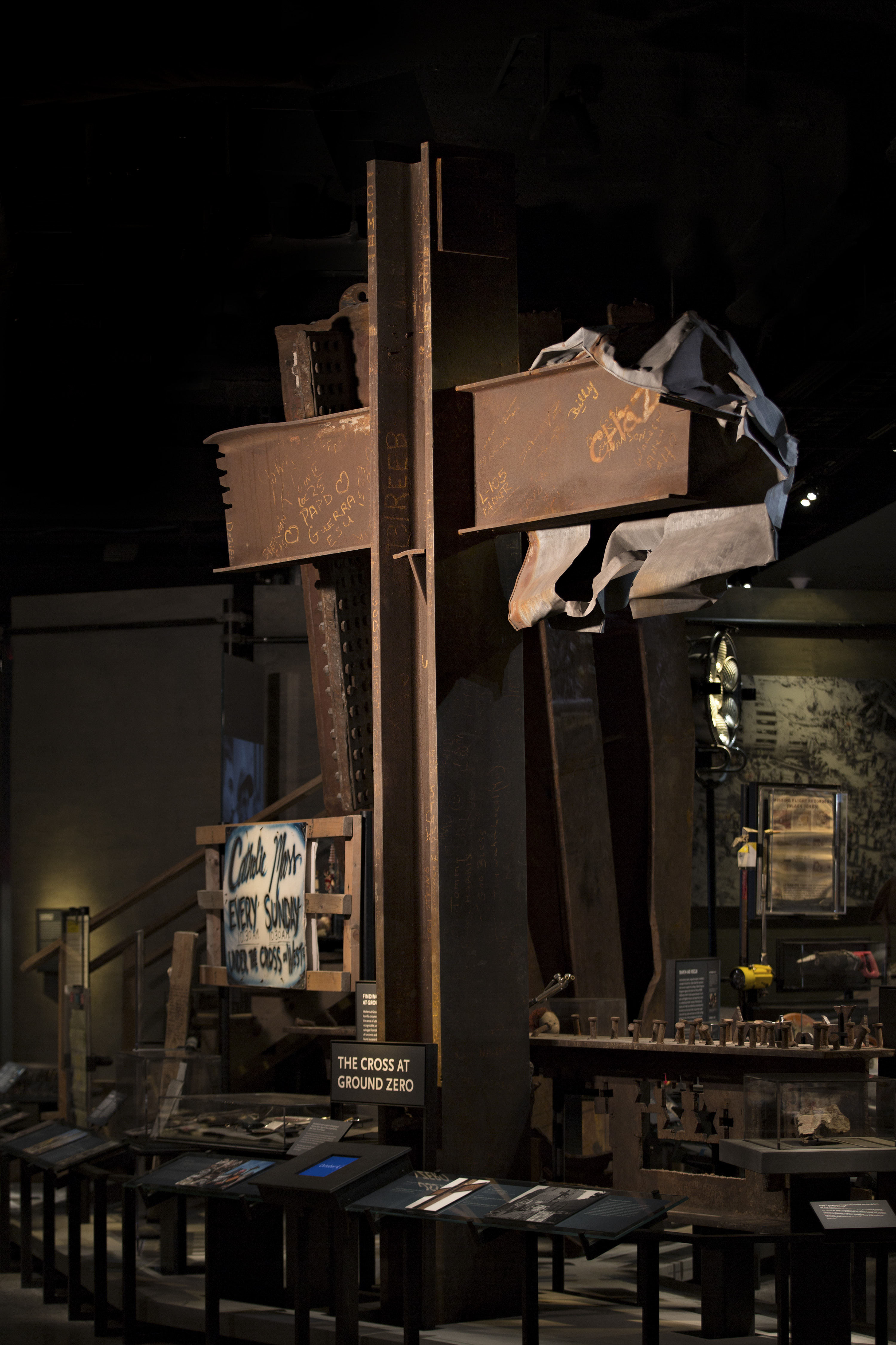 "An interior gallery displays the ""Cross at Ground Zero.""  A steel T-beam salvaged from the wreckage of the towers, it became a rallying point for rescue and recovery workers at the site."