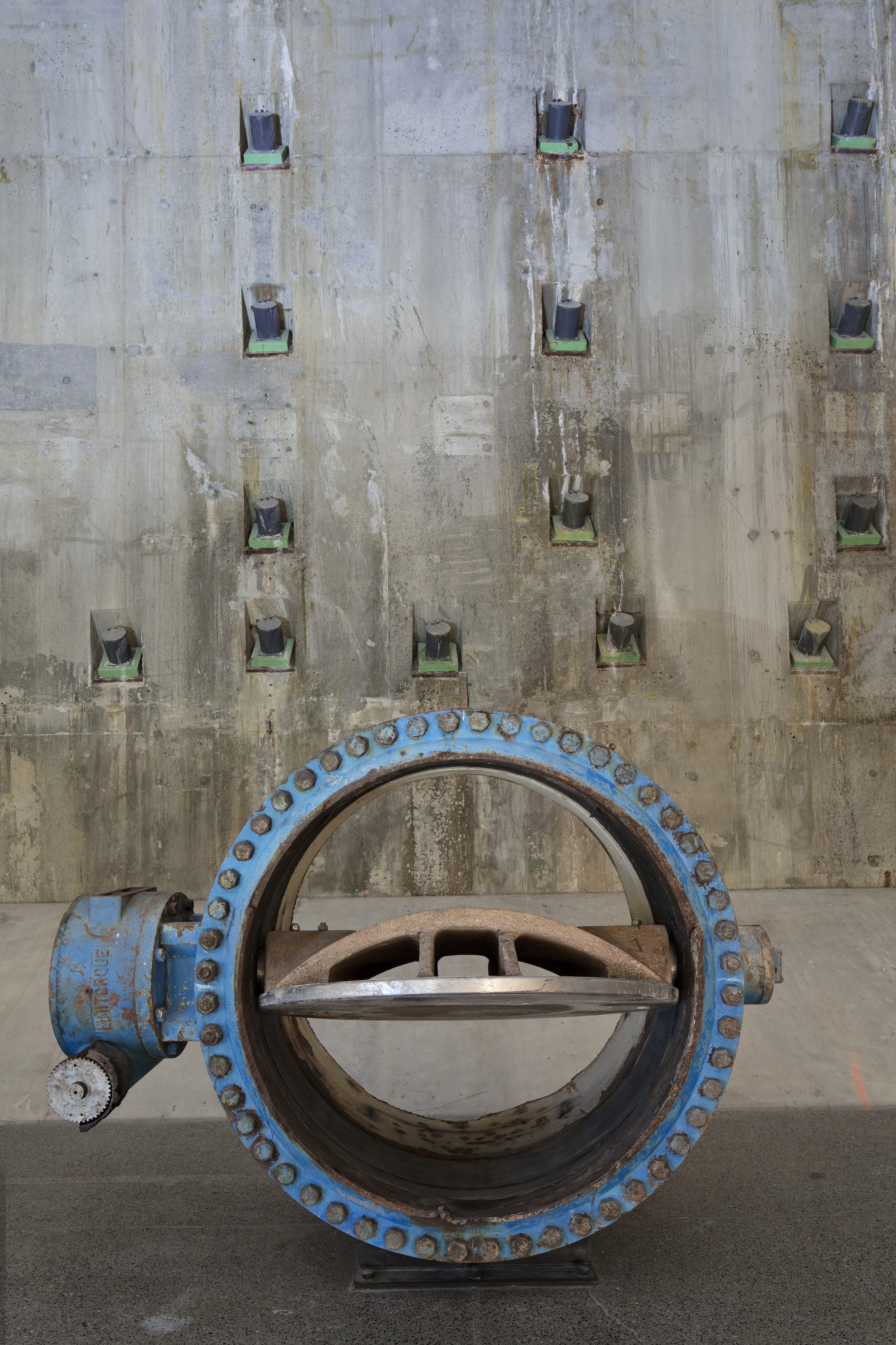 A river line valve sits in the museum's Foundation Hall before a portion of the Trade Center's slurry wall, a barrier that held firm after the towers collapsed, preventing the Hudson River from inundating lower Manhattan.