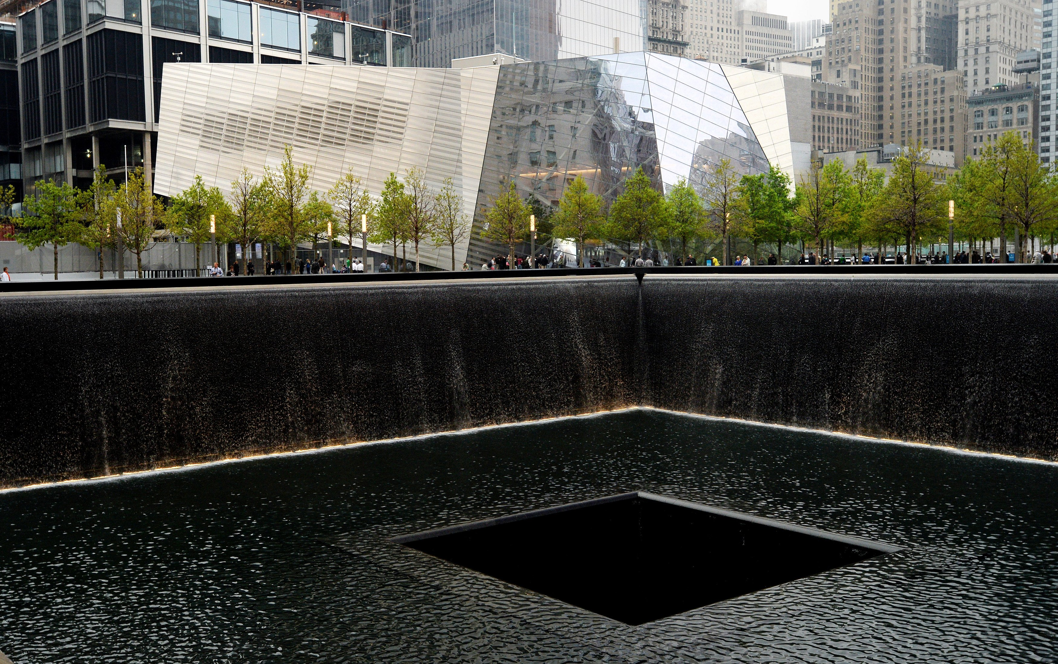 A view of the National September 11 Memorial Museum with the north reflecting pool in foreground during the museum's dedication ceremony on May 15, 2014 in New York City.