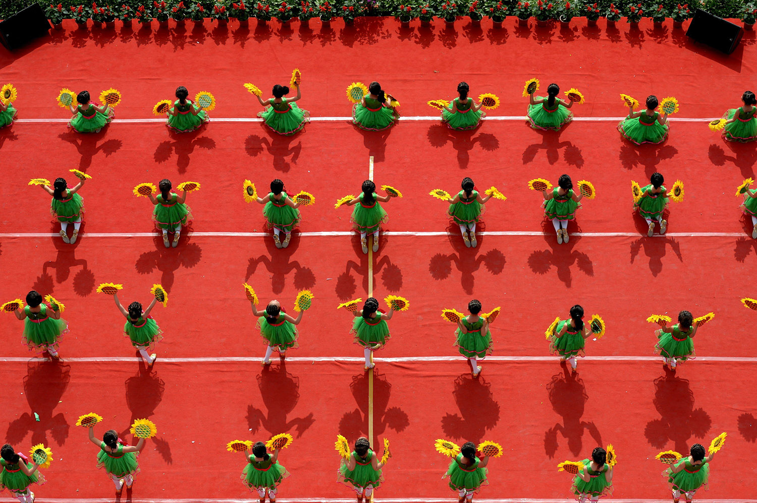 Pupils dance to celebrate the upcoming Children's Day in Xuan'en County, central China's Hubei Province, May 28, 2014.