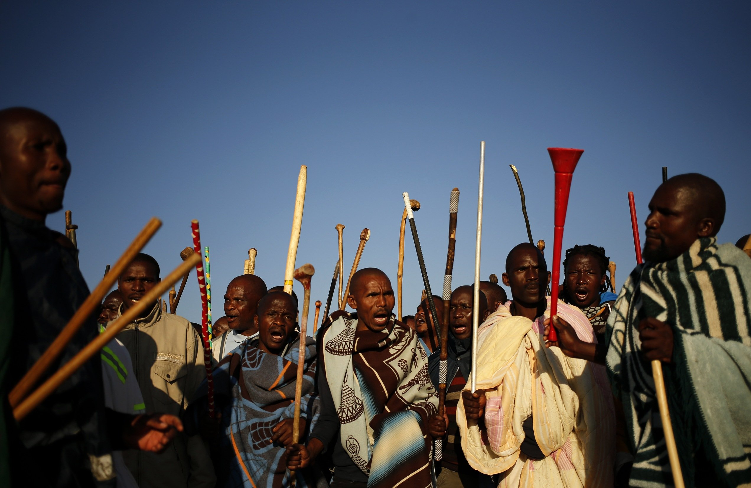 Miners on strike chant slogans as they march in Nkaneng township outside the Lonmin mine in Rustenburg, South Africa on May 14, 2014.