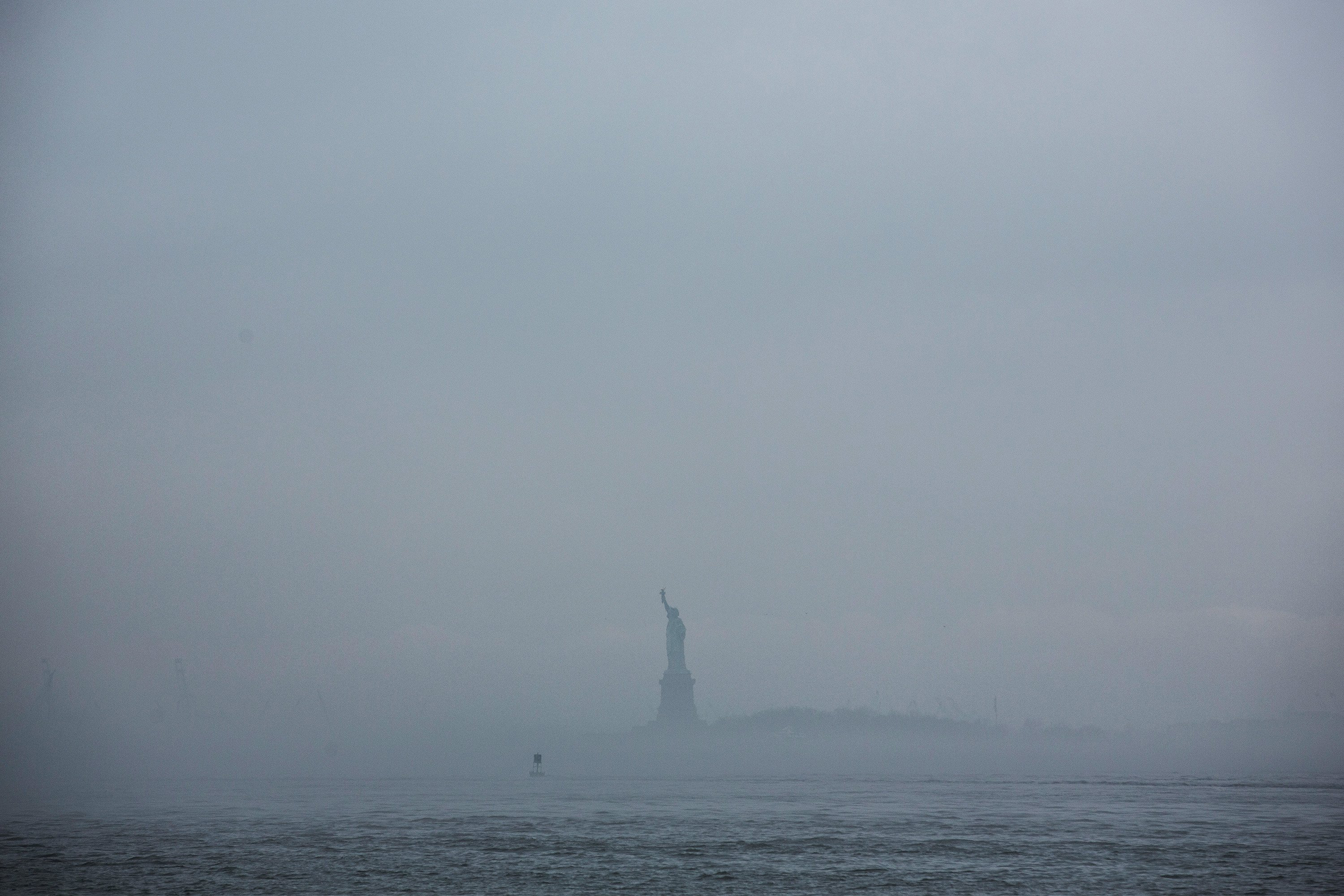 The Statue of Liberty is enveloped in fog on May 1, 2014.