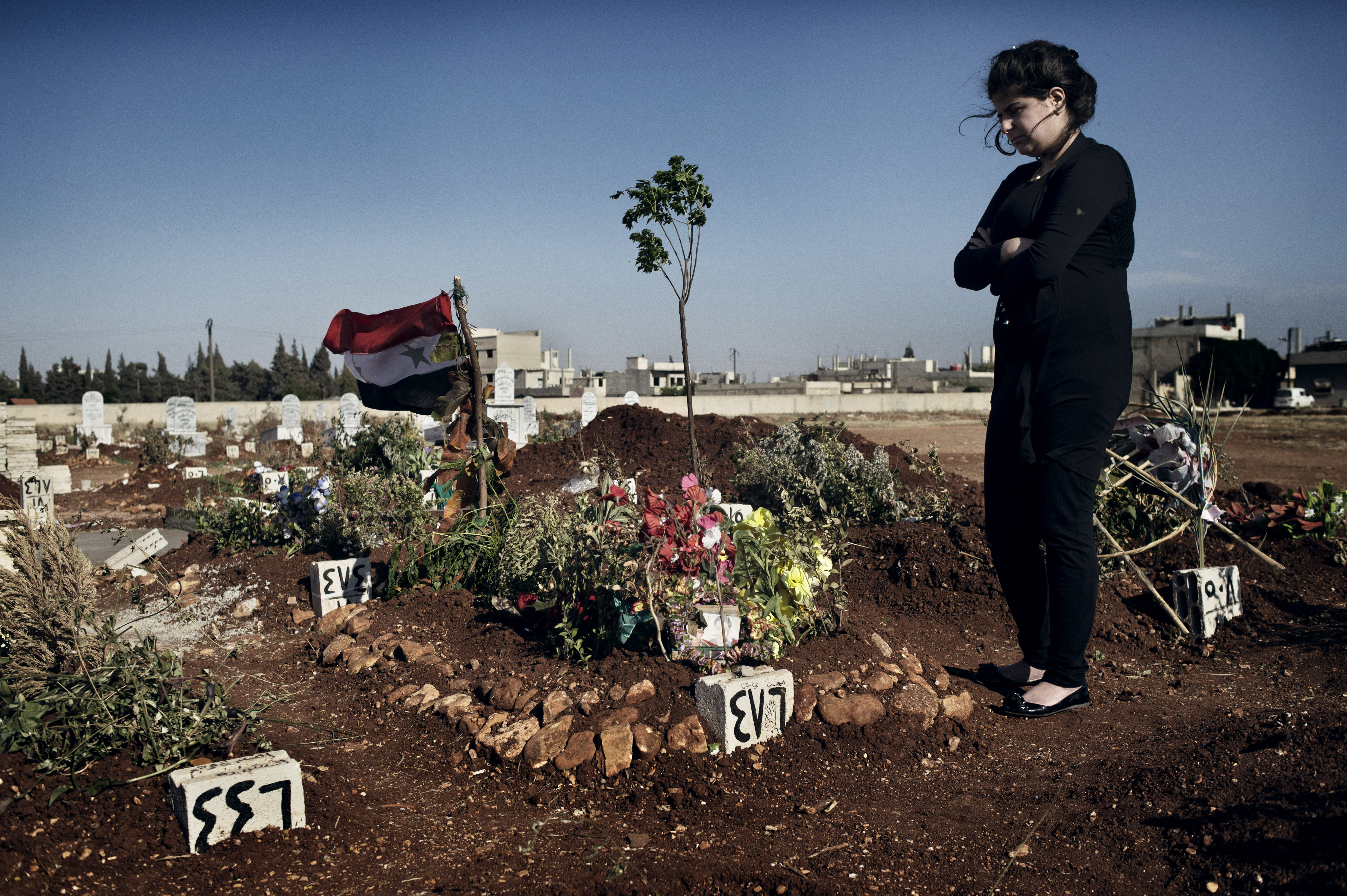 Rashan, 17, buried her husband of five months in the Martyrs of Firdous Cemetery, Zahara neighborhood, Homs.