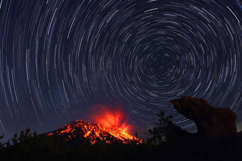 Showa crater of Sakurajima, taisho lava, and star trails in Kagoshima Prefecture in Kyushu, Japan.