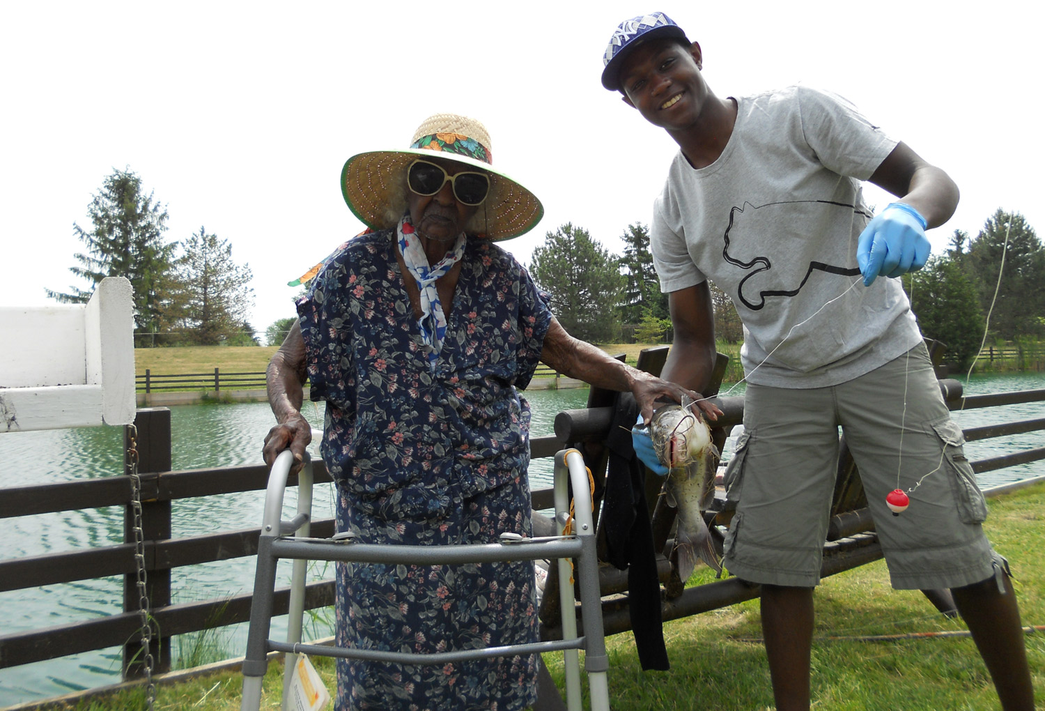 Jeralean Talley and godson Tyler Kinloch pictured with one of the seven catfish she caught at the Spring Valley Trout Farm in Dexter, Mich., on June 16, 2012.