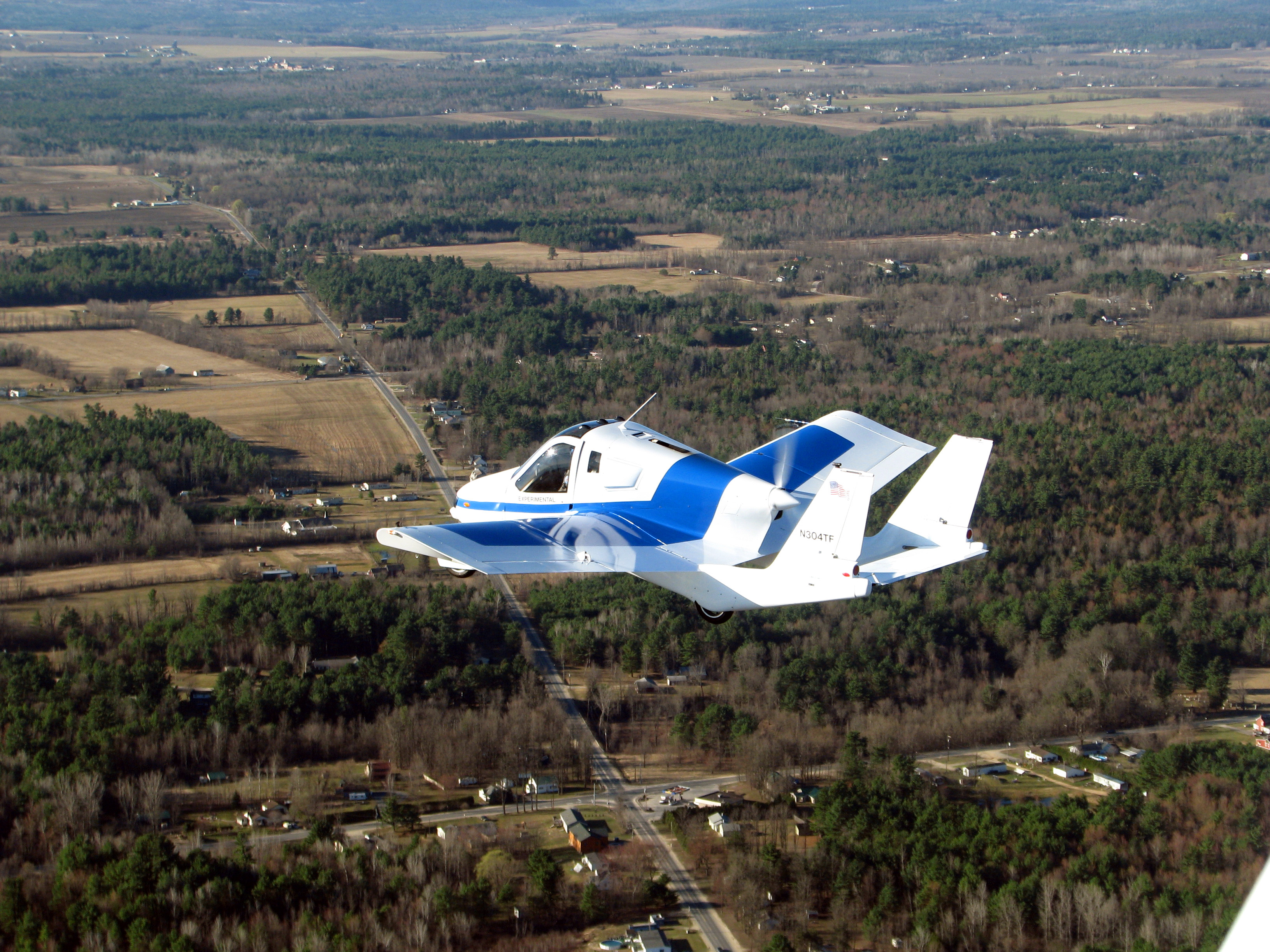 Terrafugia's prototype flying car, dubbed the Transition, during its first flight, May 23, 2012.