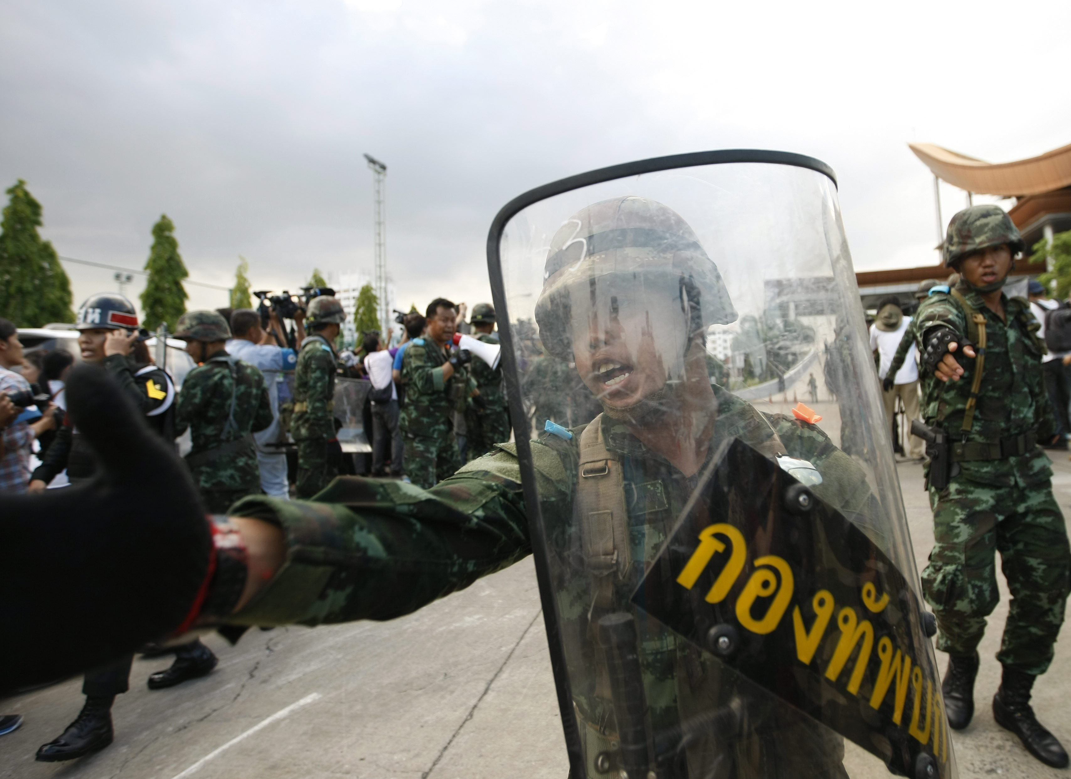 Thai armed soldiers stand guard after they used a military truck to block the entrance of the Army Club following a military coup in Bangkok on May 22, 2014.