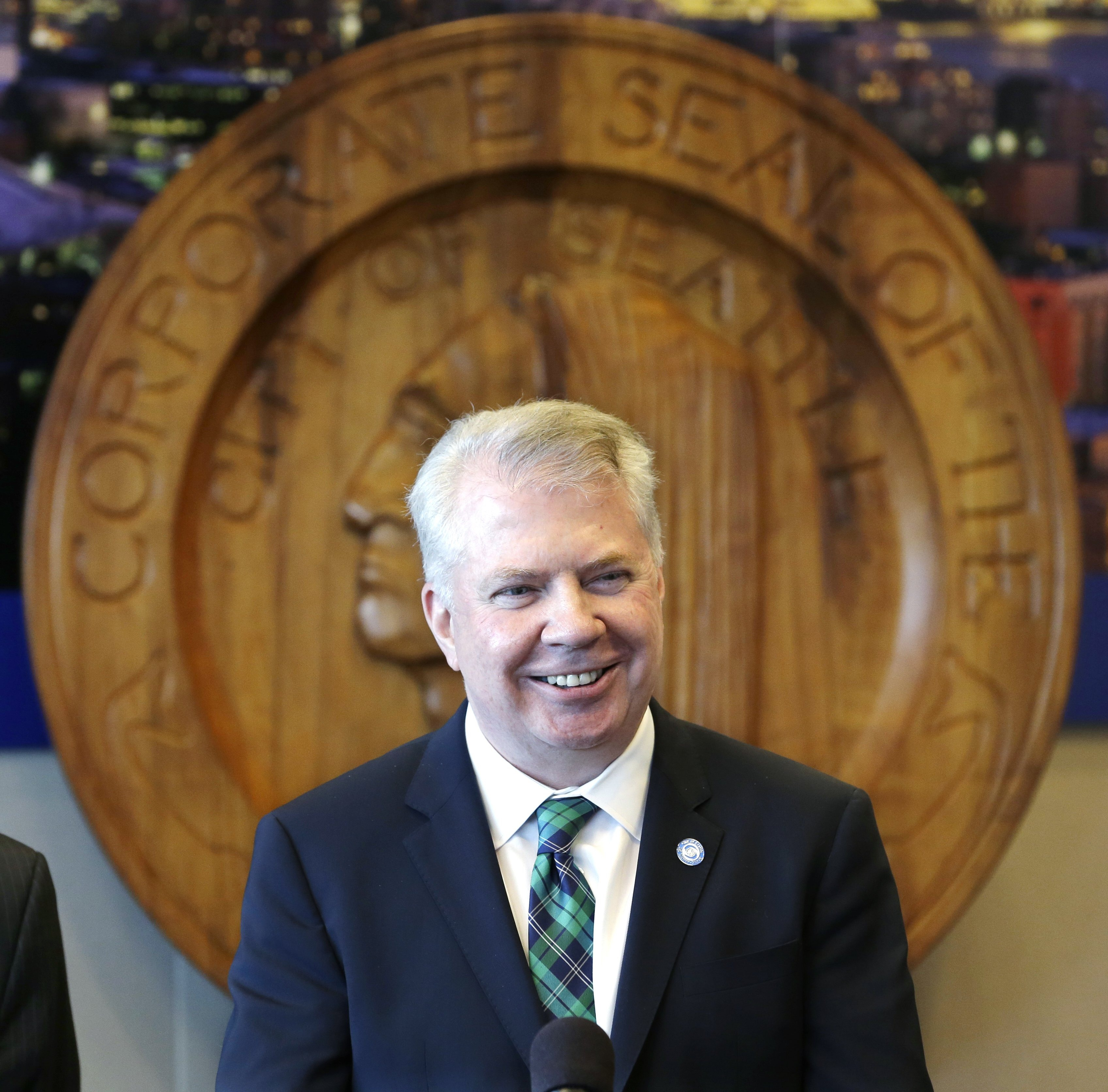 Seattle Mayor Ed Murray smiles as he addresses a news conference on a proposal to increase the minimum wage in the city Thursday, April 24, 2014, in Seattle.