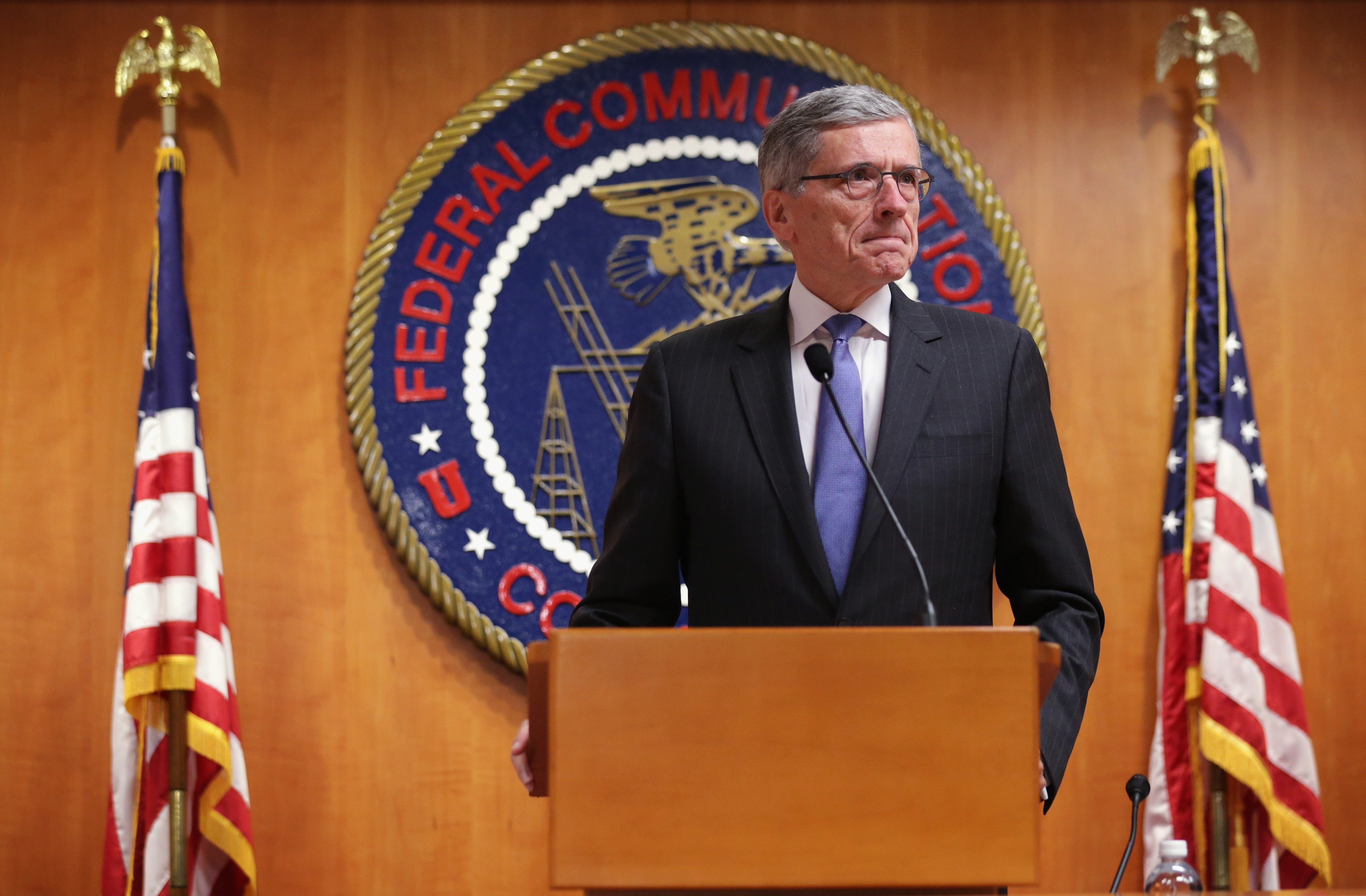 Federal Communications Commission (FCC) Chairman Tom Wheeler listens during a news conference after an open meeting to receive public comment on proposed open Internet notice of proposed rule-making and spectrum auctions on May 15, 2014 at the FCC headquarters in Washington.