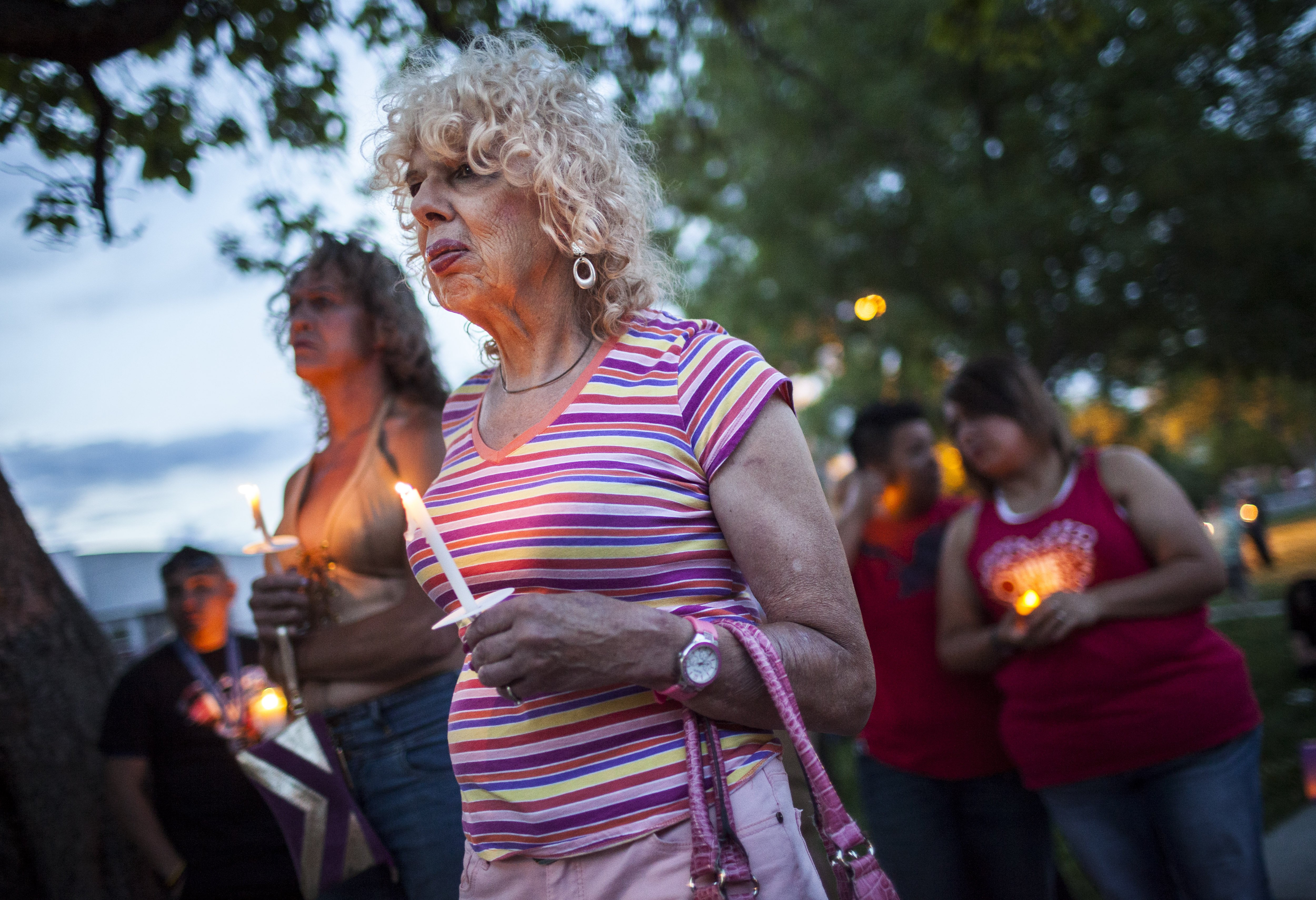 Denee Mallon, center, joins a candlelight vigil organized by Albuquerque Pride in Albuquerque, N.M on May 29, 2014. A U.S. Department of Health and Services review board ruled on May 30, in favor of Mallon, a 74-year-old Army veteran, whose request to have Medicare pay for her genital reconstruction was denied two years ago.