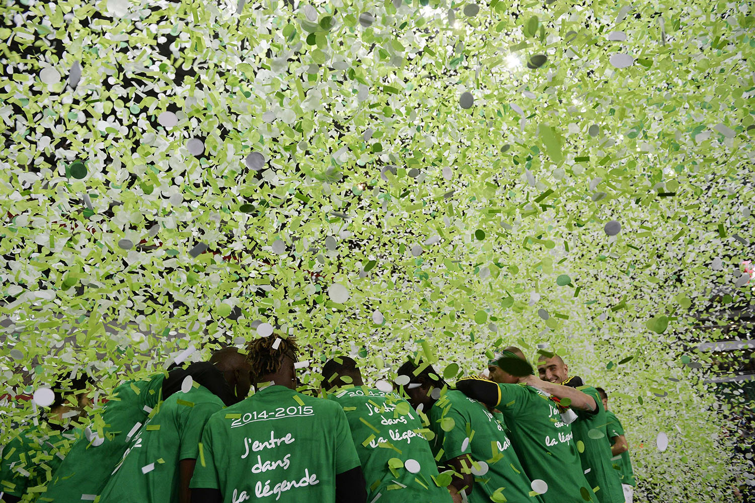 Saint-Etienne's players celebrate victory at the end of the French League football match between Saint-Etienne and Ajaccio, at the Geoffroy Guichard stadium in Saint-Etienne, central France, on May 18, 2014.