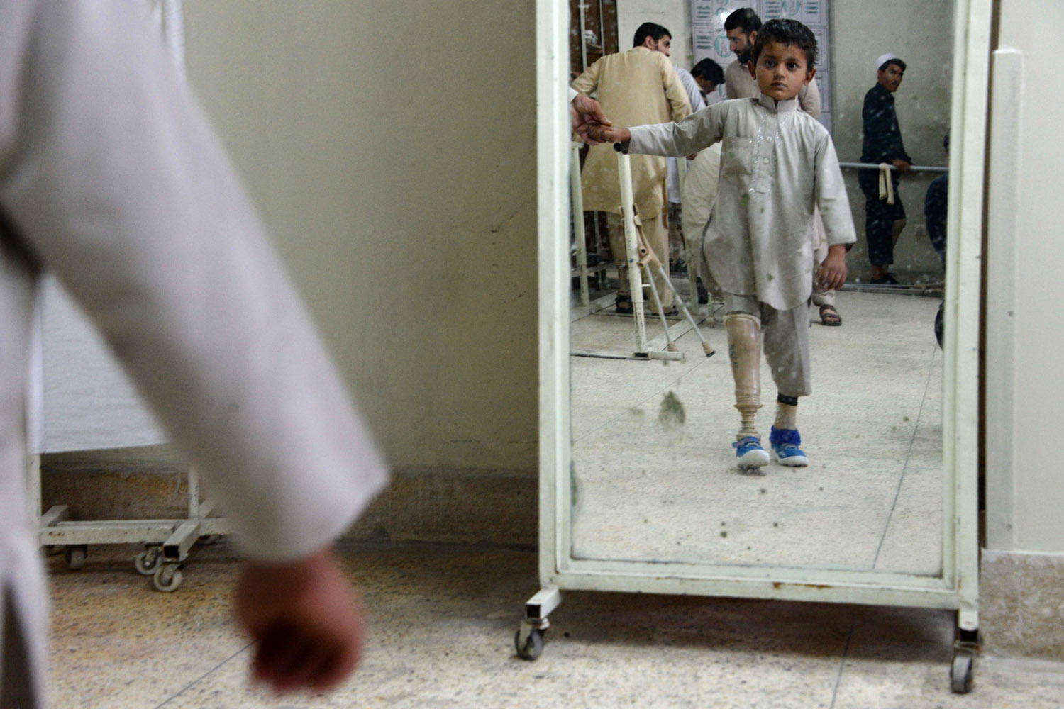 May 3, 2014. An Afghan child amputee practices walking with his prosthetic leg at one of the International Committee of the Red Cross (ICRC) hospital for war victims and the disabled in Jalalabad.
