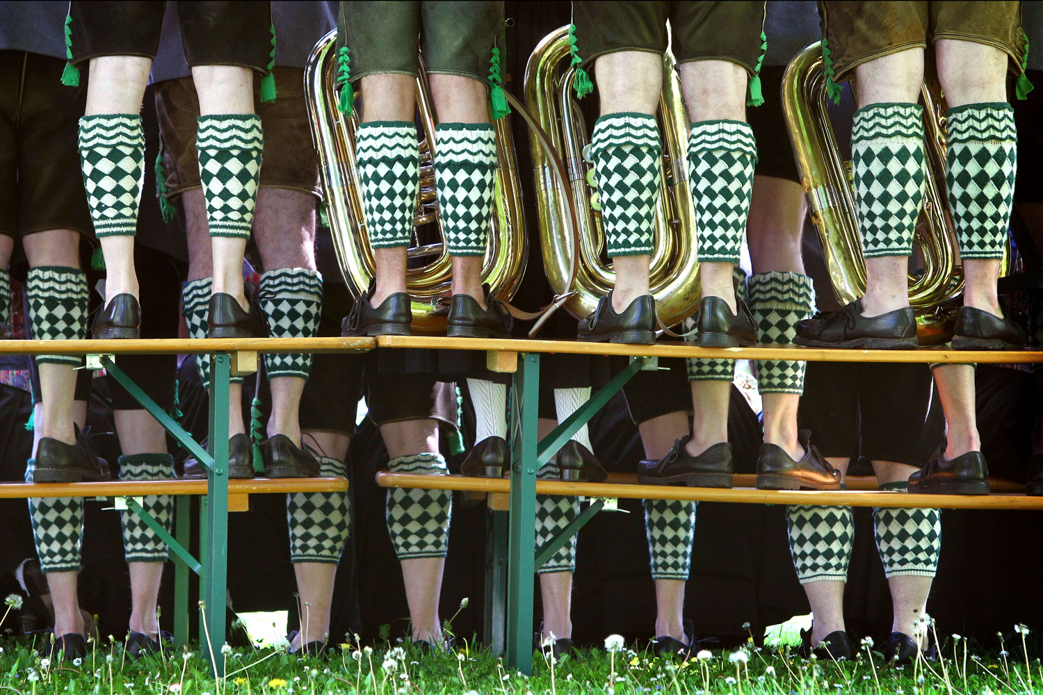 May 1, 2014. Members of a music band wear traditional Bavarian dresses as they pose for a group picture in Garmisch-Partenkirchen, southern Germany.