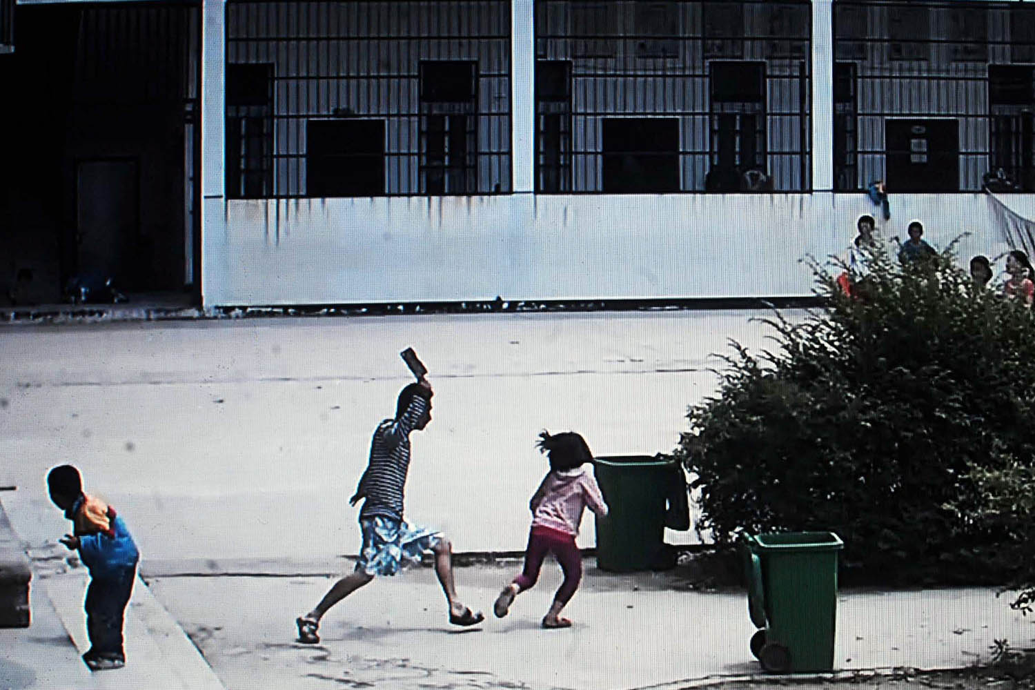 May 20, 2014. A picture taken from a security video shows a knife-wielding attacker going on a rampage at a Chinese primary school in Macheng, central China's province of Hubei, wounding eight schoolchildren with one seriously hurt.
