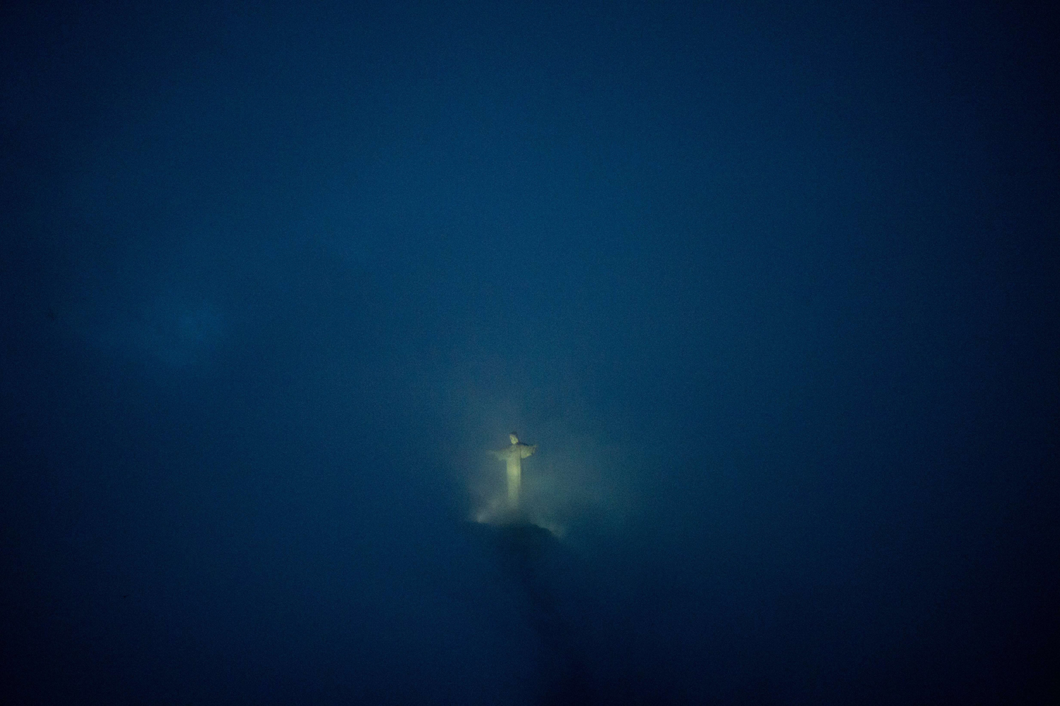 May 23, 2014. The Christ the Reedemer statue atop the Corcovado mountain is seen at night in Rio de Janeiro on Brazil