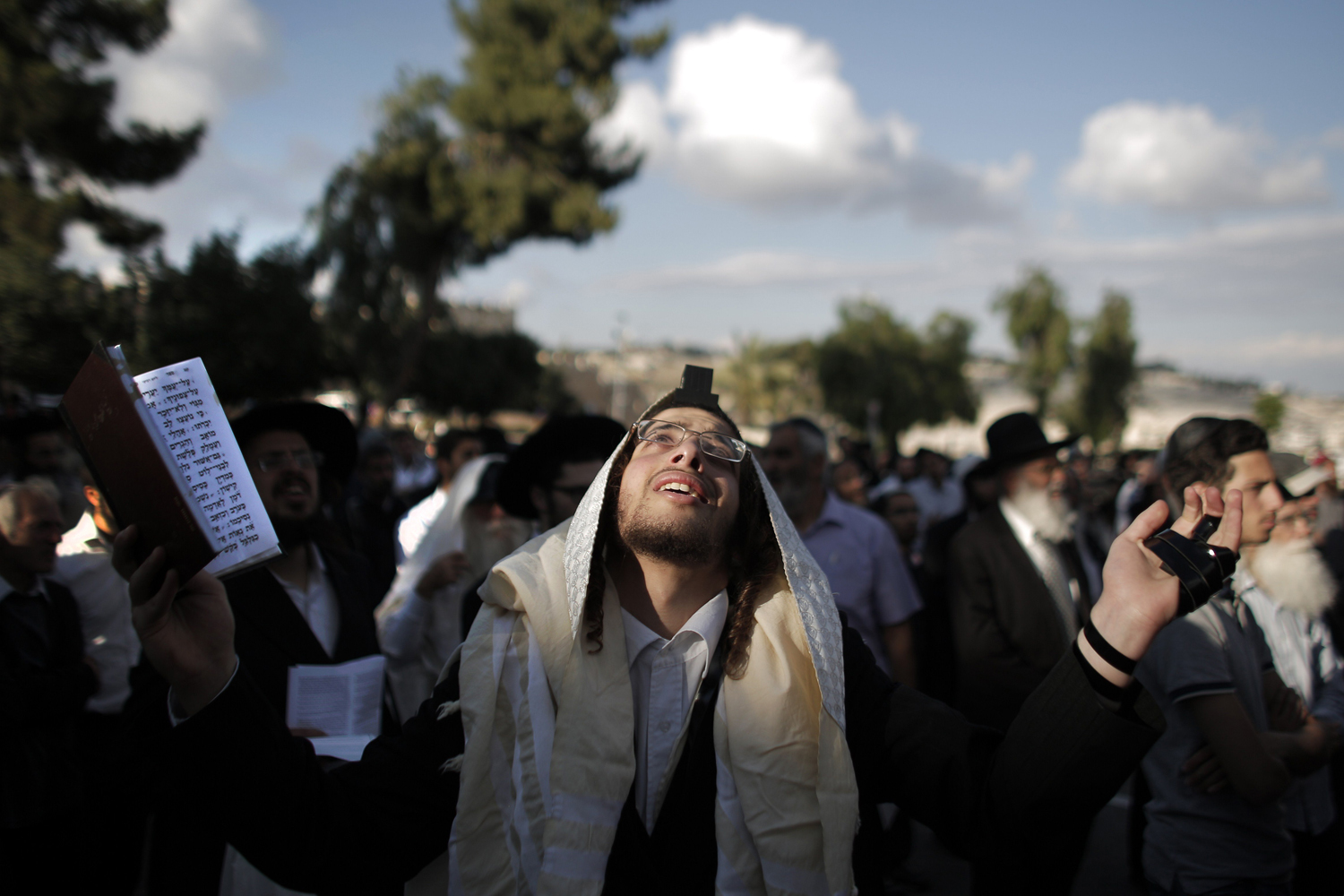 May 12, 2014. Ultra-Orthodox Jewish men pray during a protest against Pope Francis' upcoming visit in the Old City of Jerusalem, near King David's tomb.