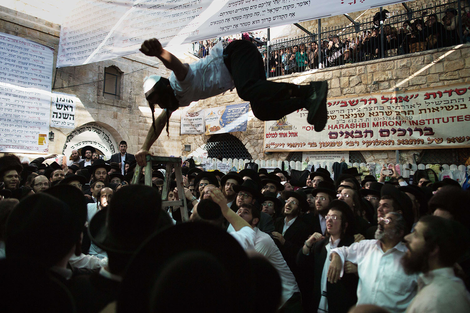 Ultra-Orthodox Jews dance at the grave site of Rabbi Shimon Bar Yochai in the northern Israeli village of Meron on May 18, 2014, at the start of the day-long holiday of Lag Baomer that commemorates the Jewish scholar's death.
