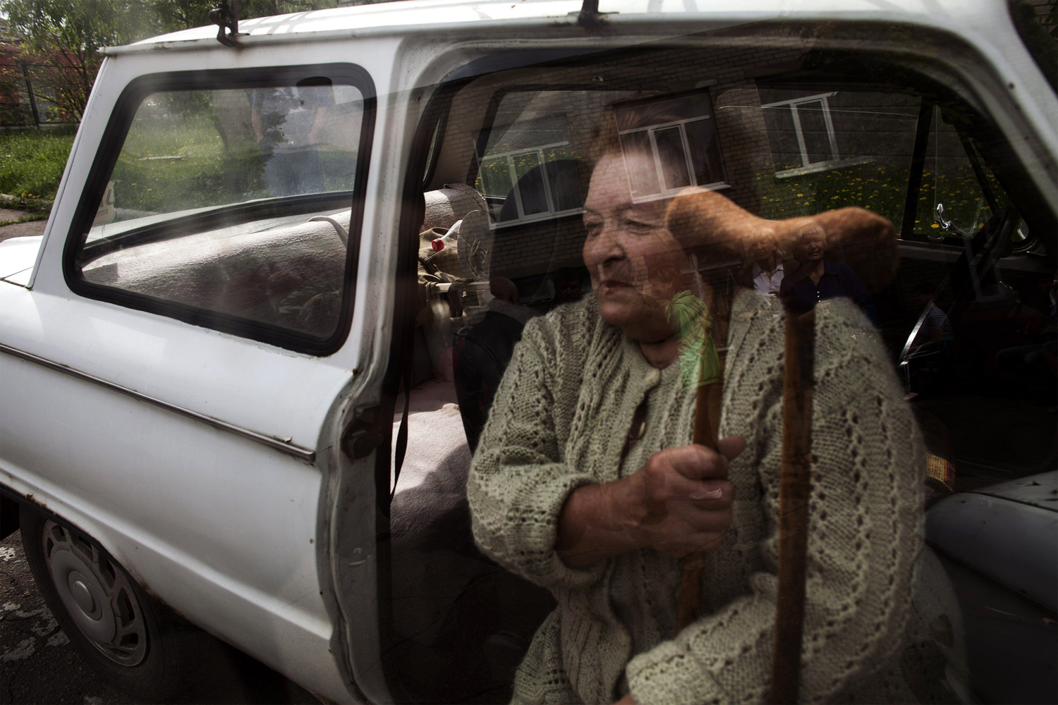 May 11, 2014. An elderly Ukrainian woman waits for help to go to vote at a polling station in the Ukrainian city of Budennovskiy.