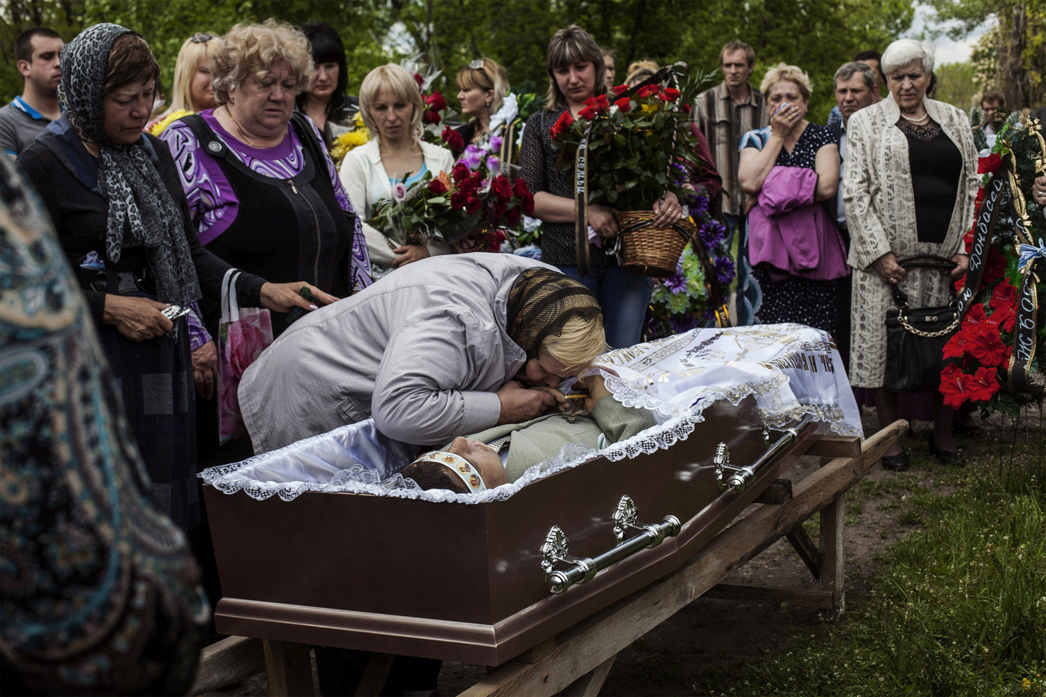 May 13, 2014. Relatives of Hyudych Vadim Yurievichq, including his mother, center, mourn his death, at the Krasnoarmeysk cemetery, eastern Ukraine, May 13, 2014.
