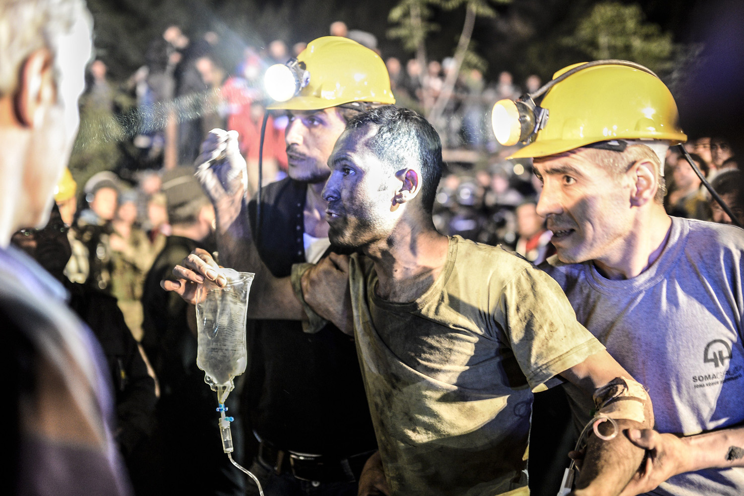 A miner came out helped by friends after an explosion in Manisa, Turkey, May 13, 2014.