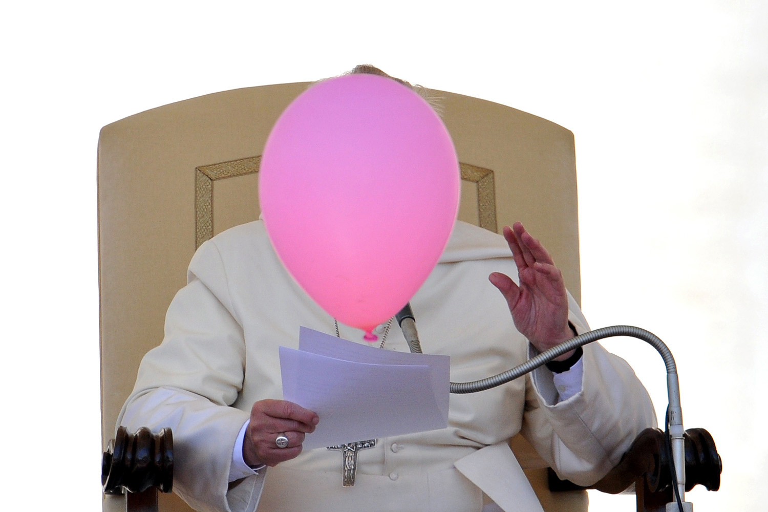 A balloon flies past Pope Francis during his general audience in St. Peter's Square at the Vatican on May 14, 2014.