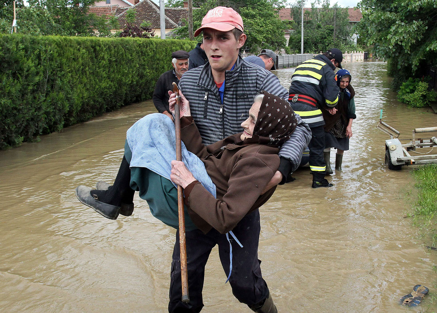 A Serbian rescue worker carries an elderly woman out of her flooded house in the Serbian village of Obrez on May 17, 2014
