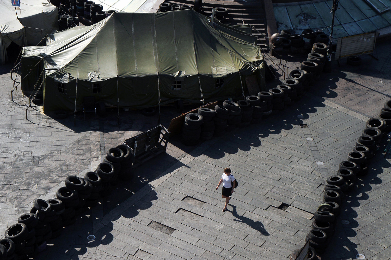 May 26, 2014. A woman walks near barricades of Maidan protesters on Independence Square  in Kiev.