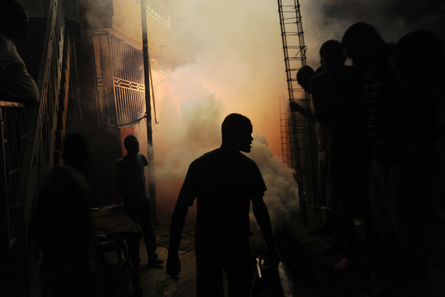 May 21, 2014. Workers from Haiti's  Ministry of Public Health and Population spray chemicals to exterminate mosquitoes in a neighborhood of Petion Ville in Port-au-Prince.