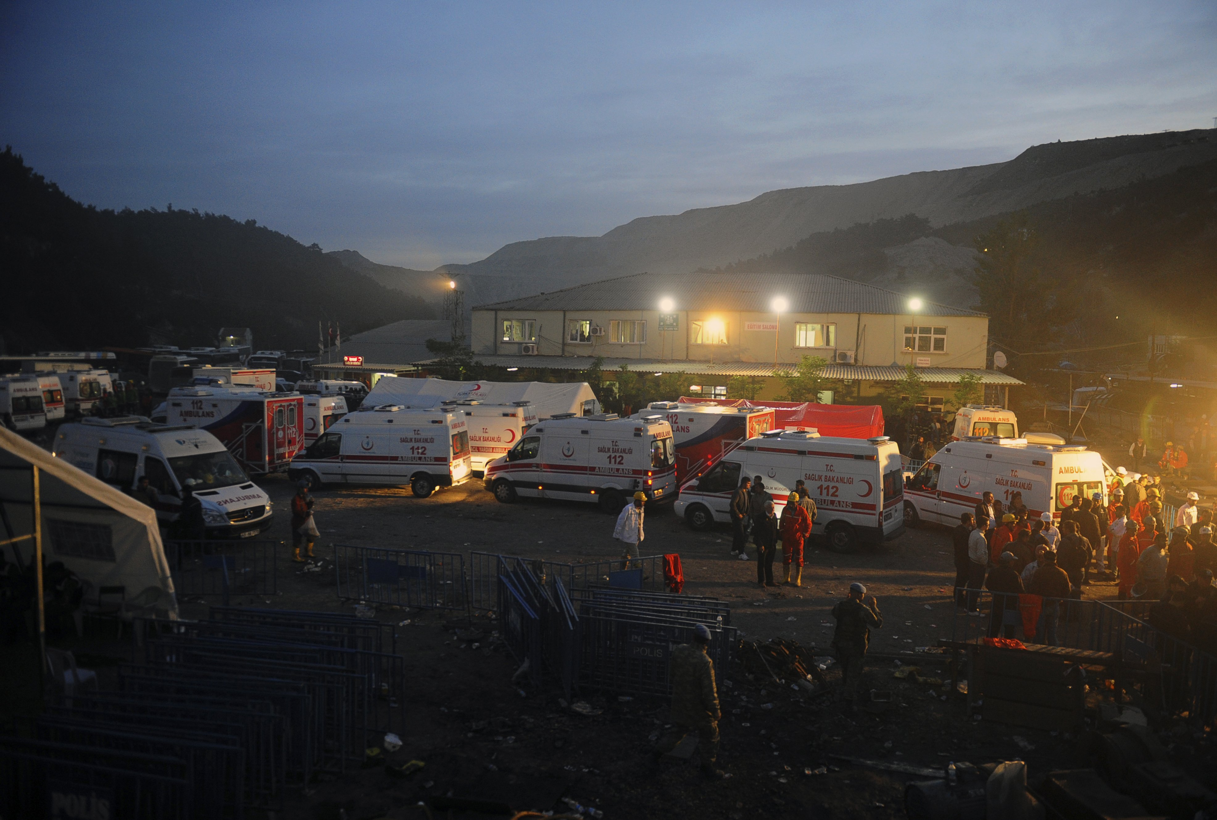 Family members and miners gather around ambulances waiting outside a coal mine in Soma, western Turkey, early Wednesday, May 14, 2014.
