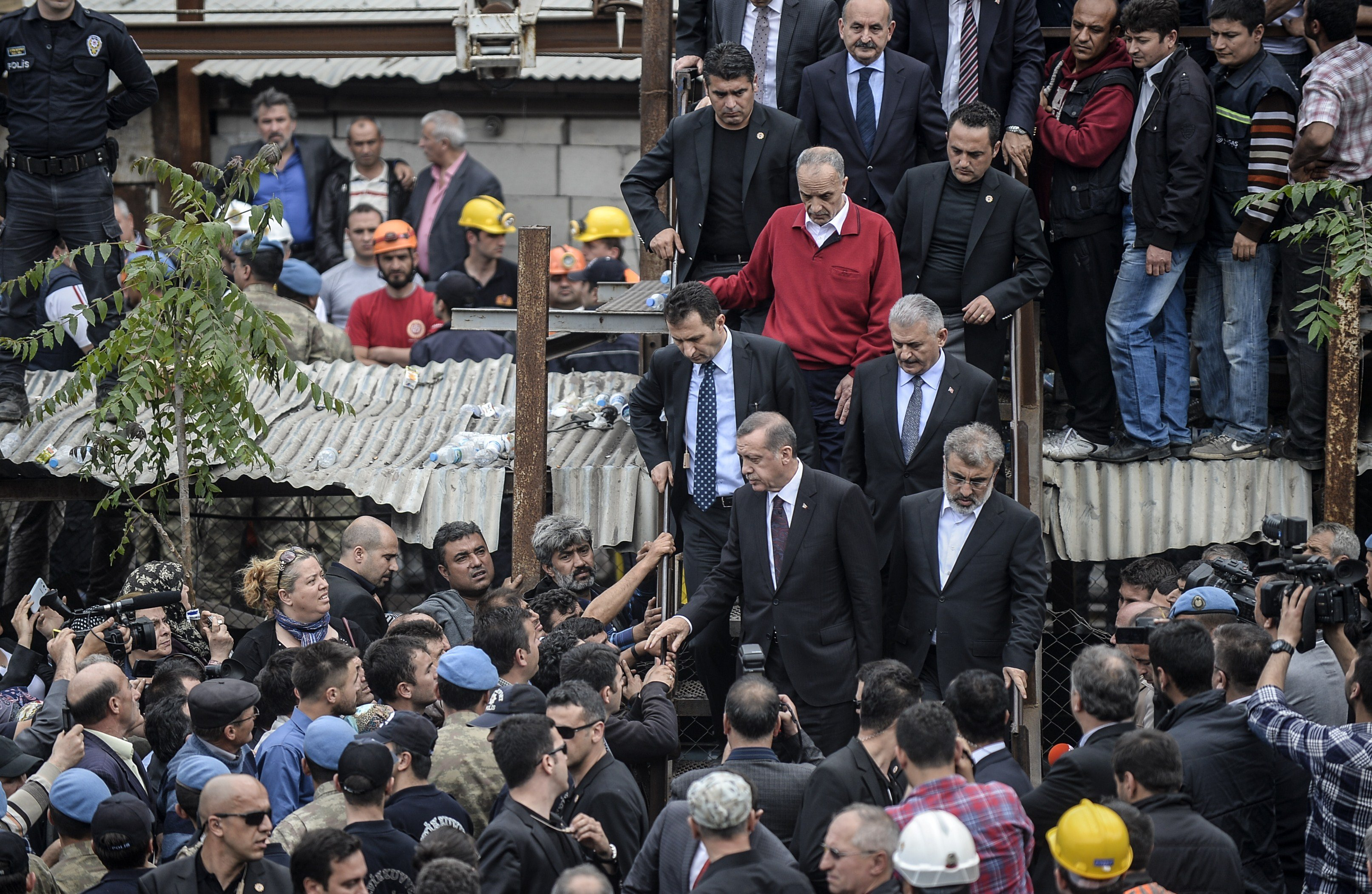 Turkish prime minister Recep Tayyip Erdogan visits the site where 120 workers were believed to remain trapped in a mine after a deadly explosion that claimed the lives of well over 200 people on May 14, 2014 in a coal mine of the western Turkish province of Manisa.