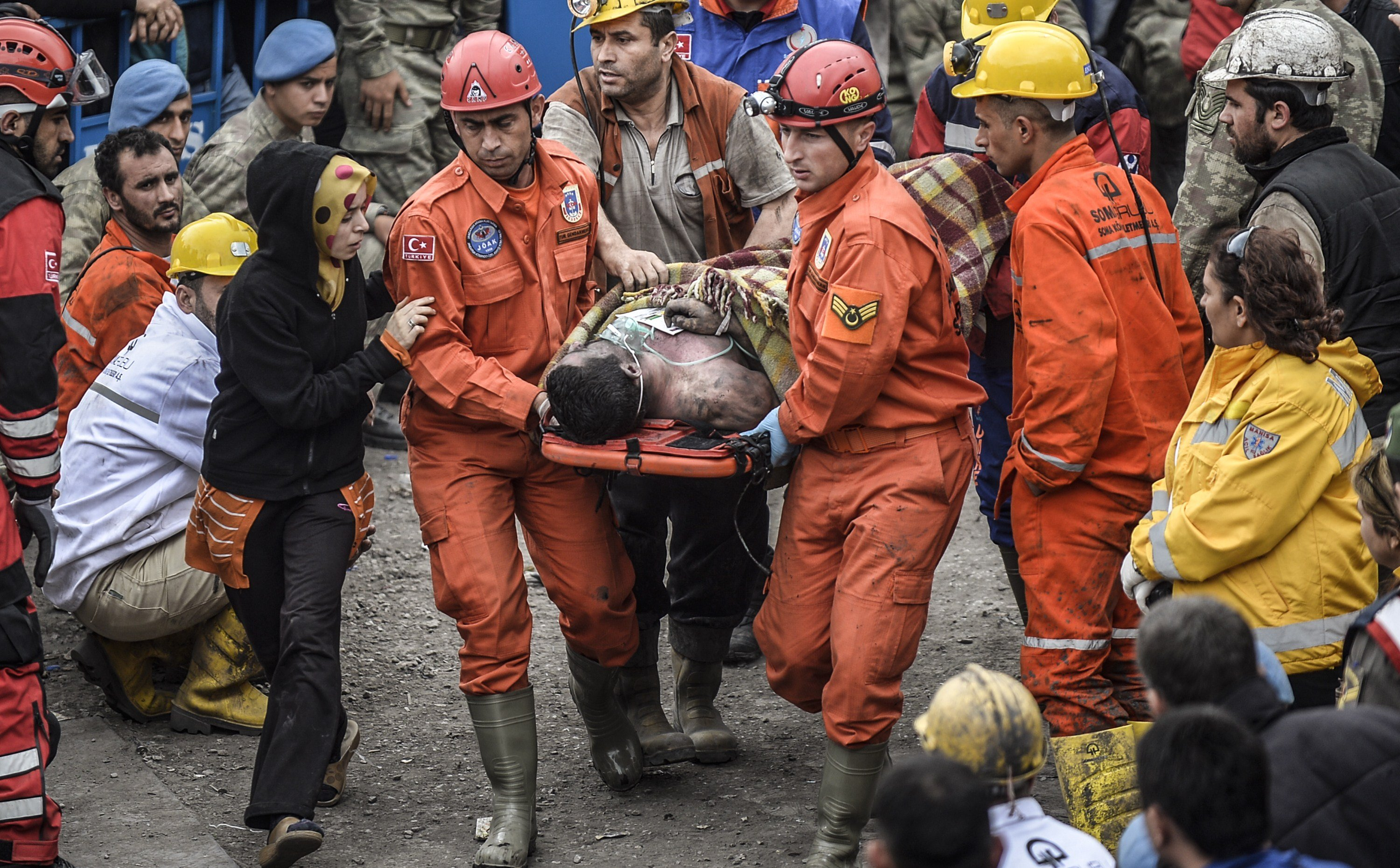 A woman reacts as she searches for relatives while rescuers carry out dead miners on May 14, 2014.