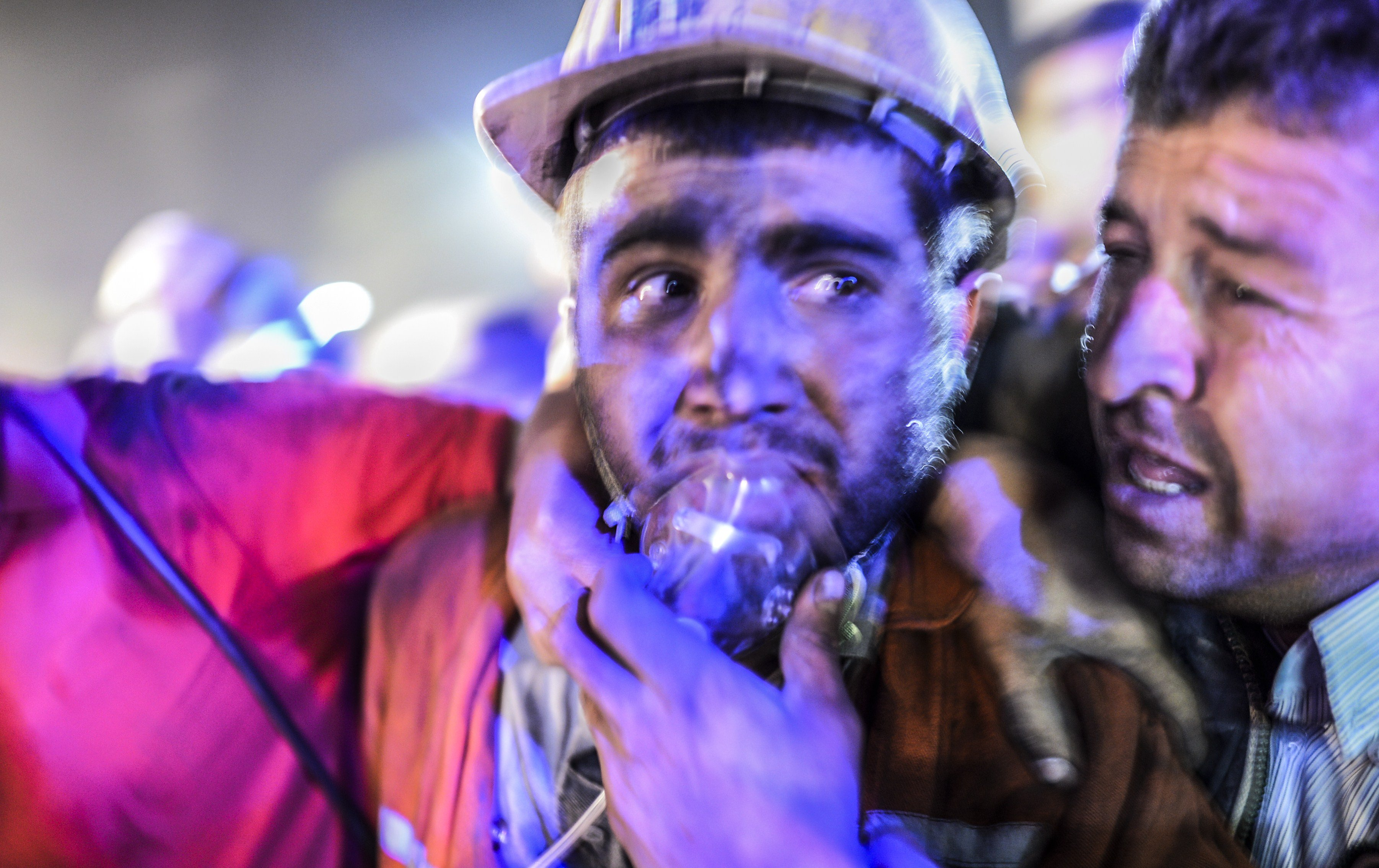 A miner with his father after an explosion on May 13, 2014 in Manisa.