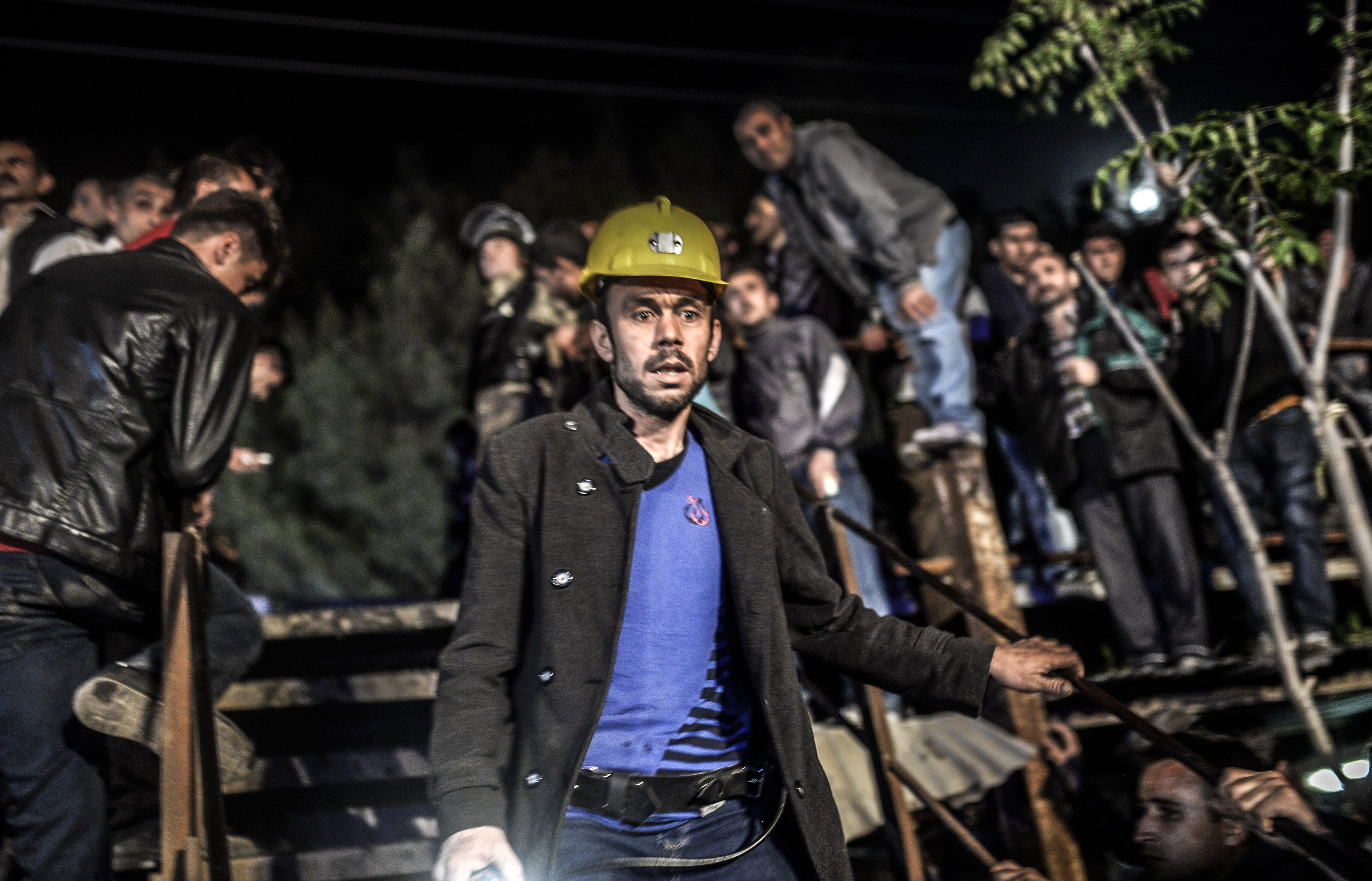 Miners wait at the gate of a mine after an explosion in Manisa on May 13, 2014.