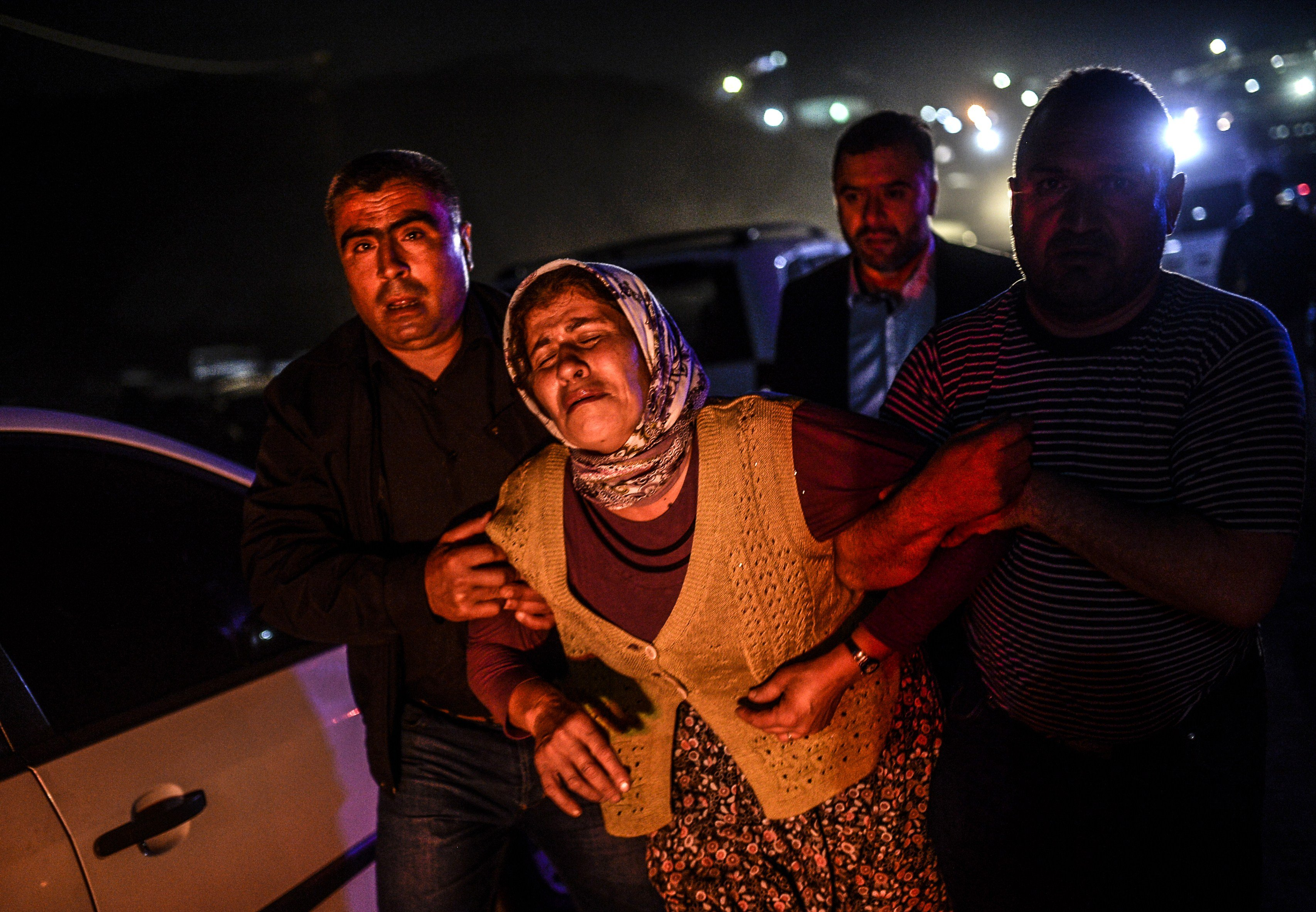 People cry after their relatives died in an explosion in Manisa on May 13, 2014.