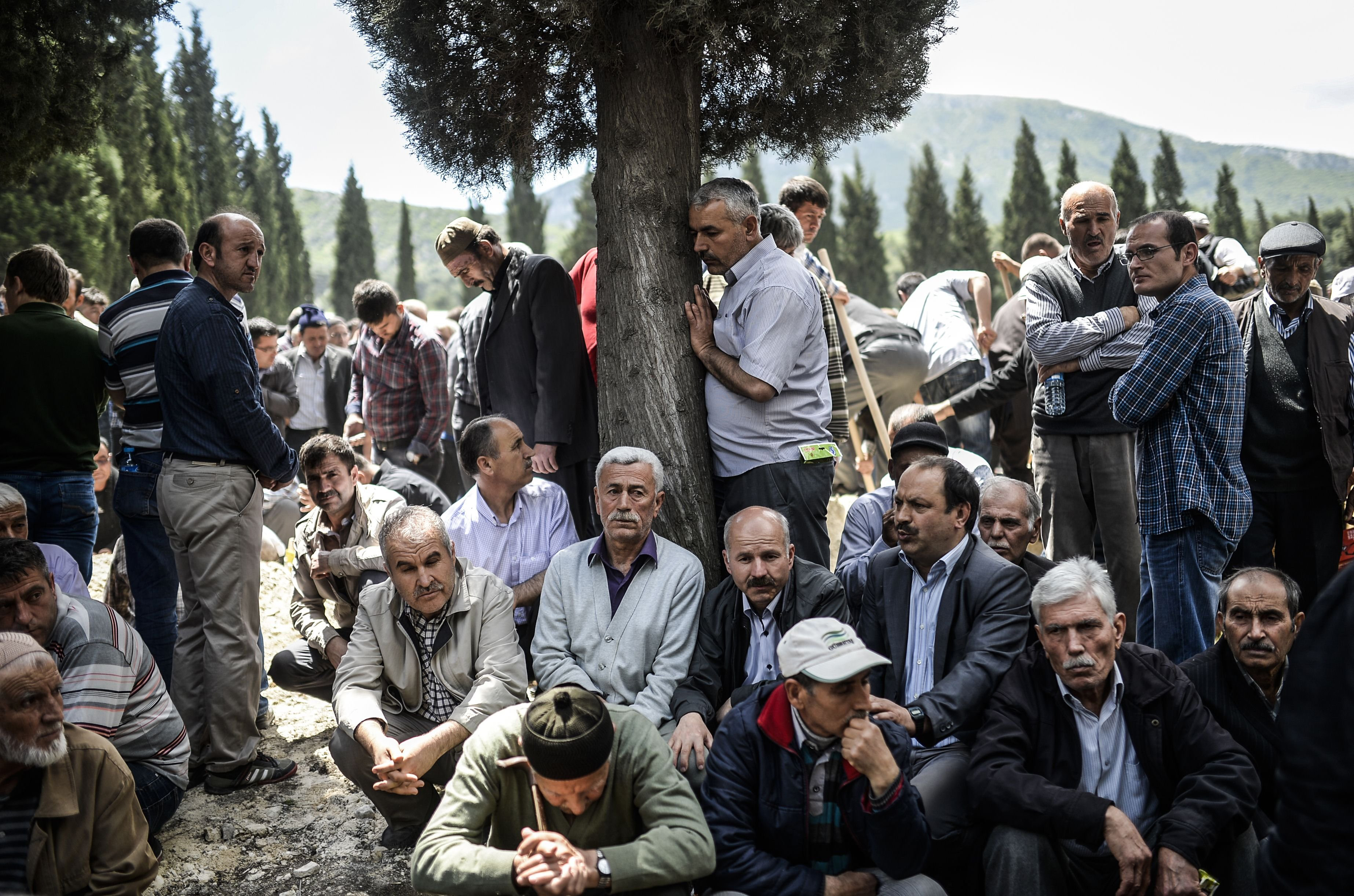 People mourn in a cemetery during the funeral ceremony of miners who died in an explosion on May 15, 2014, in the western town of Soma in the Manisa province.