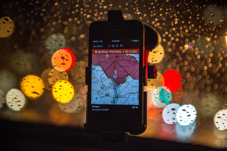 The Uber driver app on the windshield of UberX driver Regan Rucker, indicates surge pricing during peak ridership on April 4, 2014 in Washington.