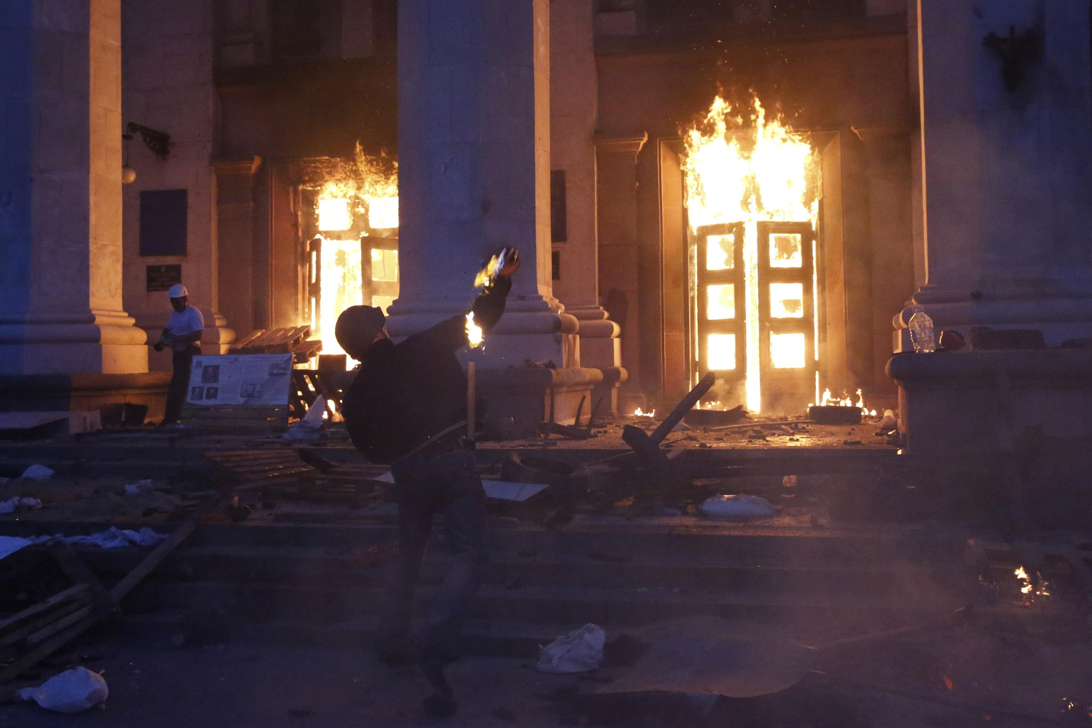 A protester throws a petrol bomb at the trade union building in Odessa, Ukraine May 2, 2014.