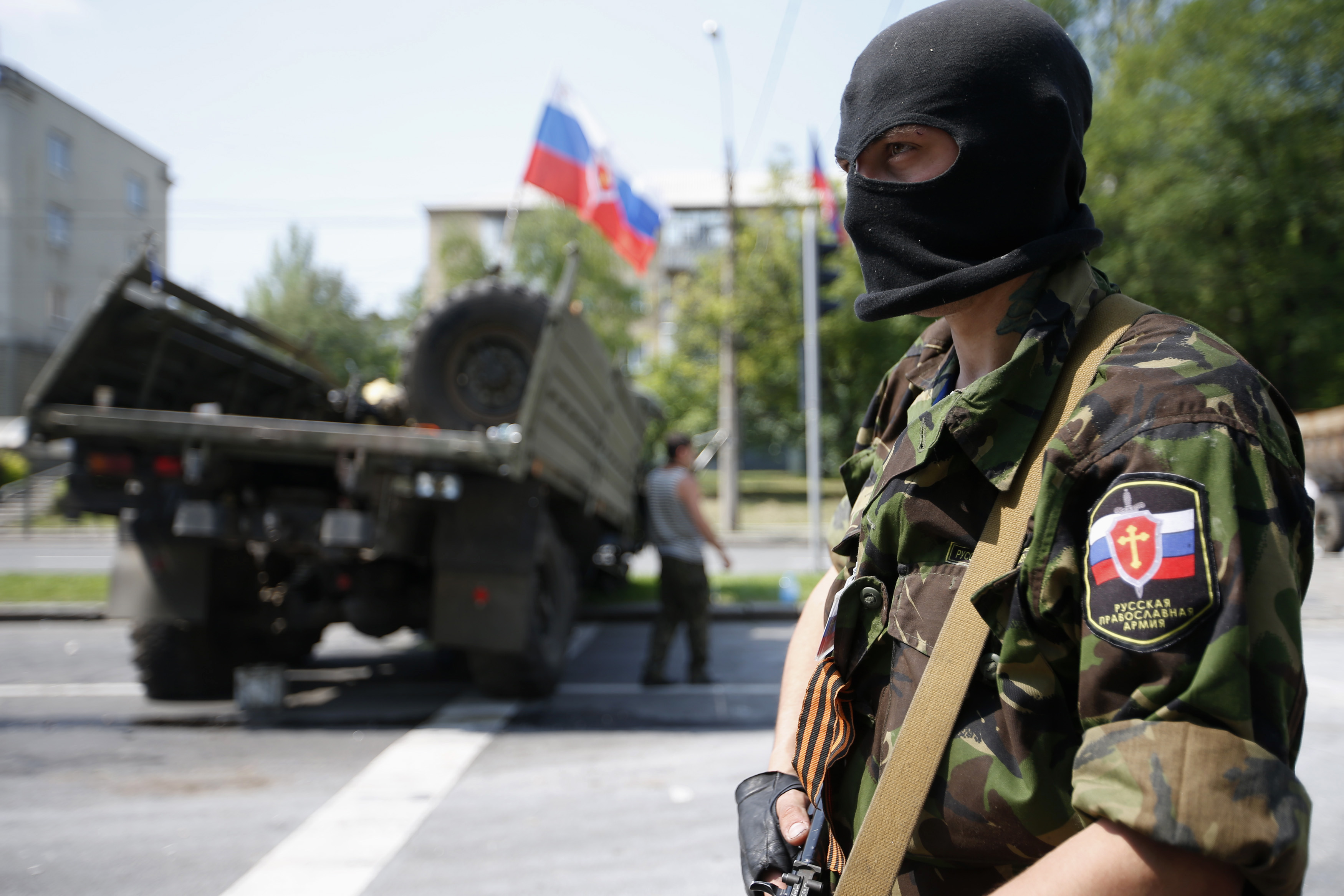 A member of a newly-formed pro-Russian armed group called the Russian Orthodox Army mans a barricade near Donetsk airport on May 29, 2014 in Donetsk, Ukraine.