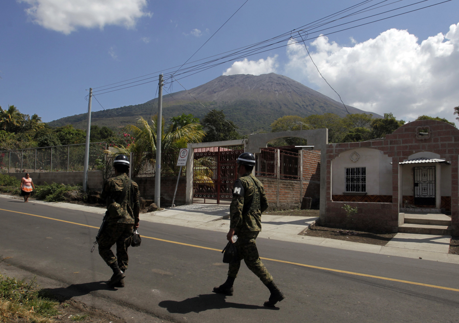 Salvadorean soldiers walk near the area of the Chaparrastique volcano in the municipality of Placitas outside San Salvador February 13, 2014.