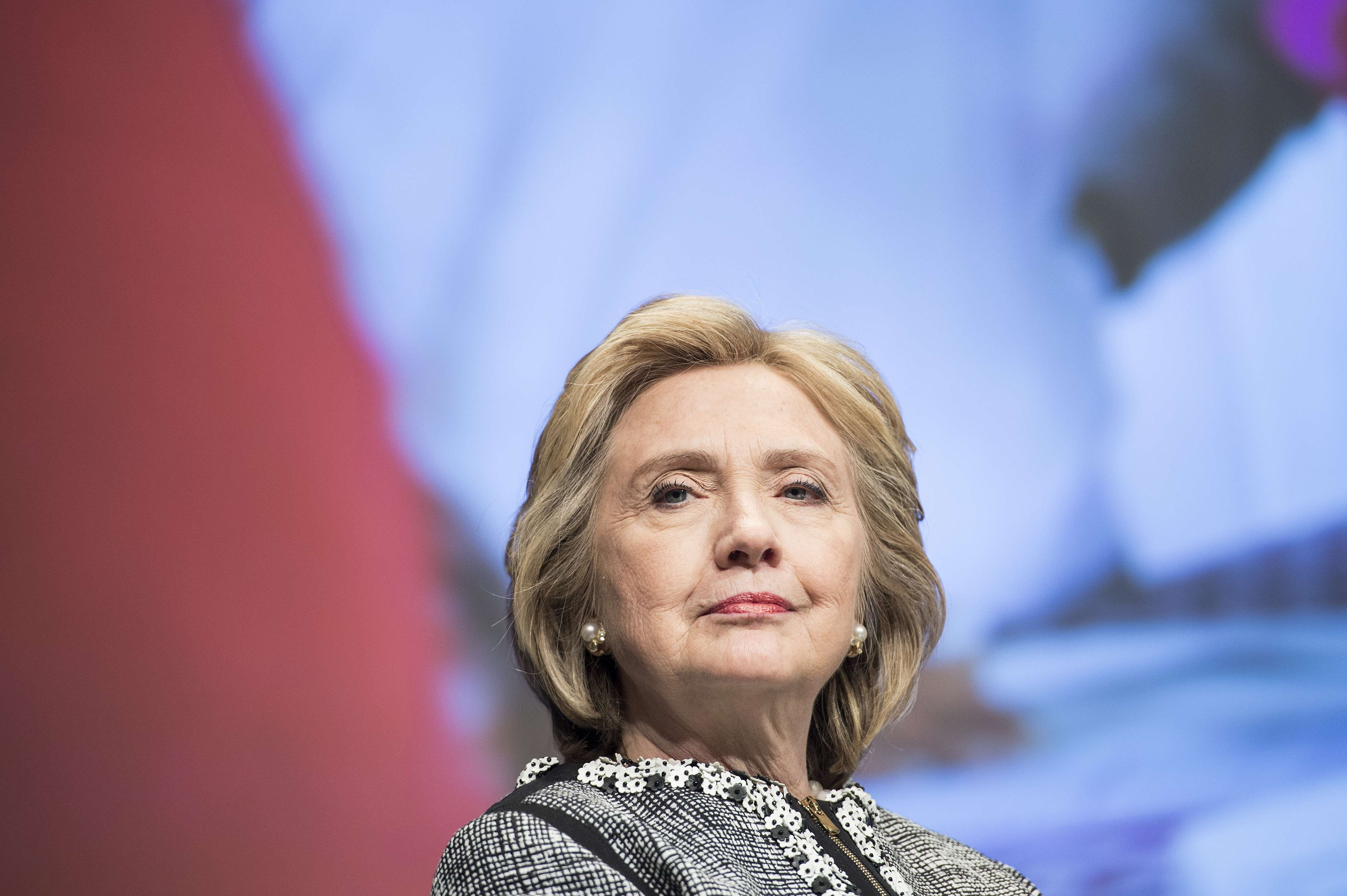 Former Secretary of State Hillary Clinton waits to speak at the World Bank on May 14, 2014 in Washington.
