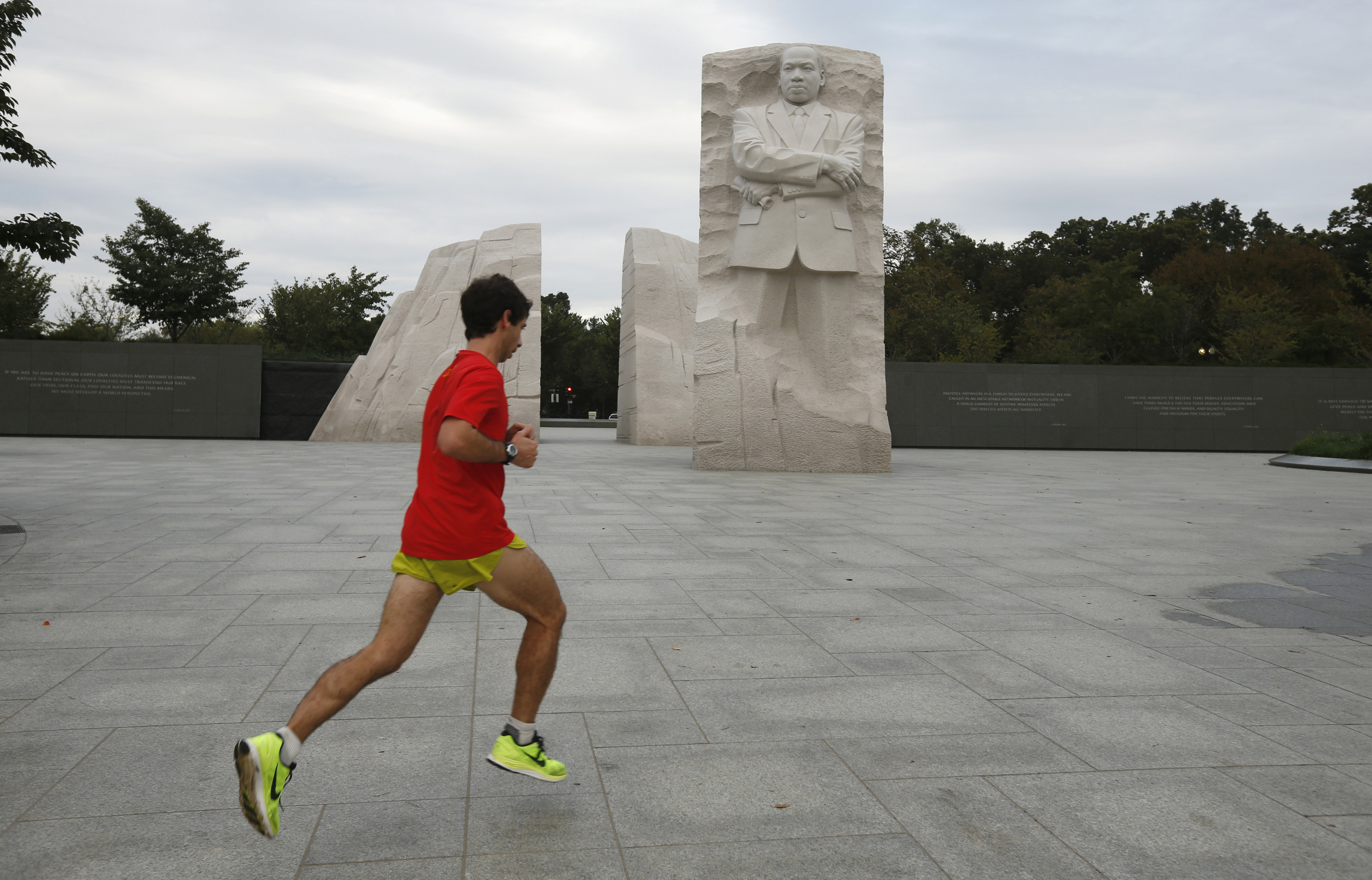 A jogger passes the Martin Luther King Jr. Memorial after it was re-opened to the public in Washington on October 17, 2013.