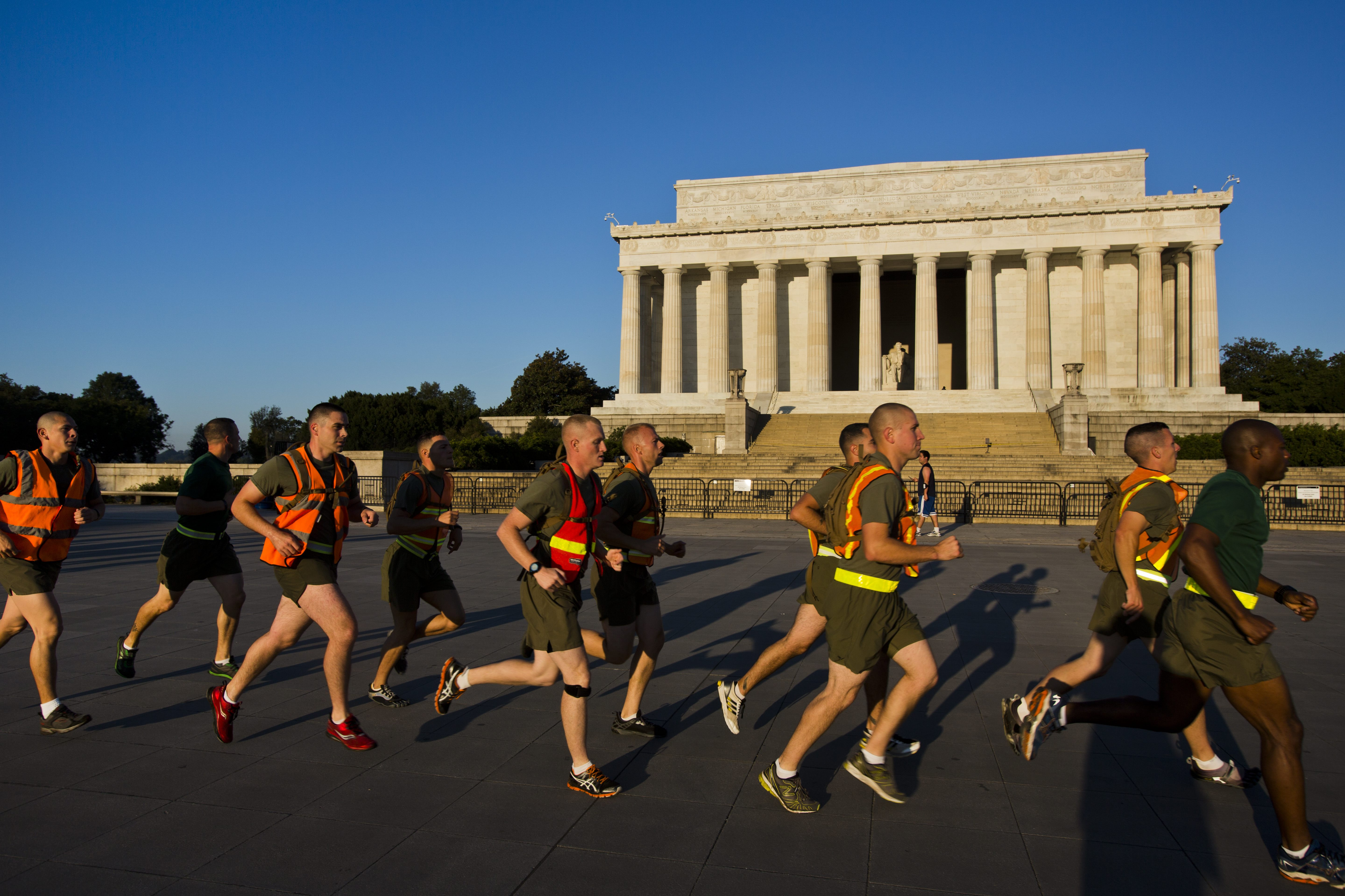 Marines jog past the Lincoln Memorial on the second day of a partial government shutdown in Washington, on October 2, 2013.